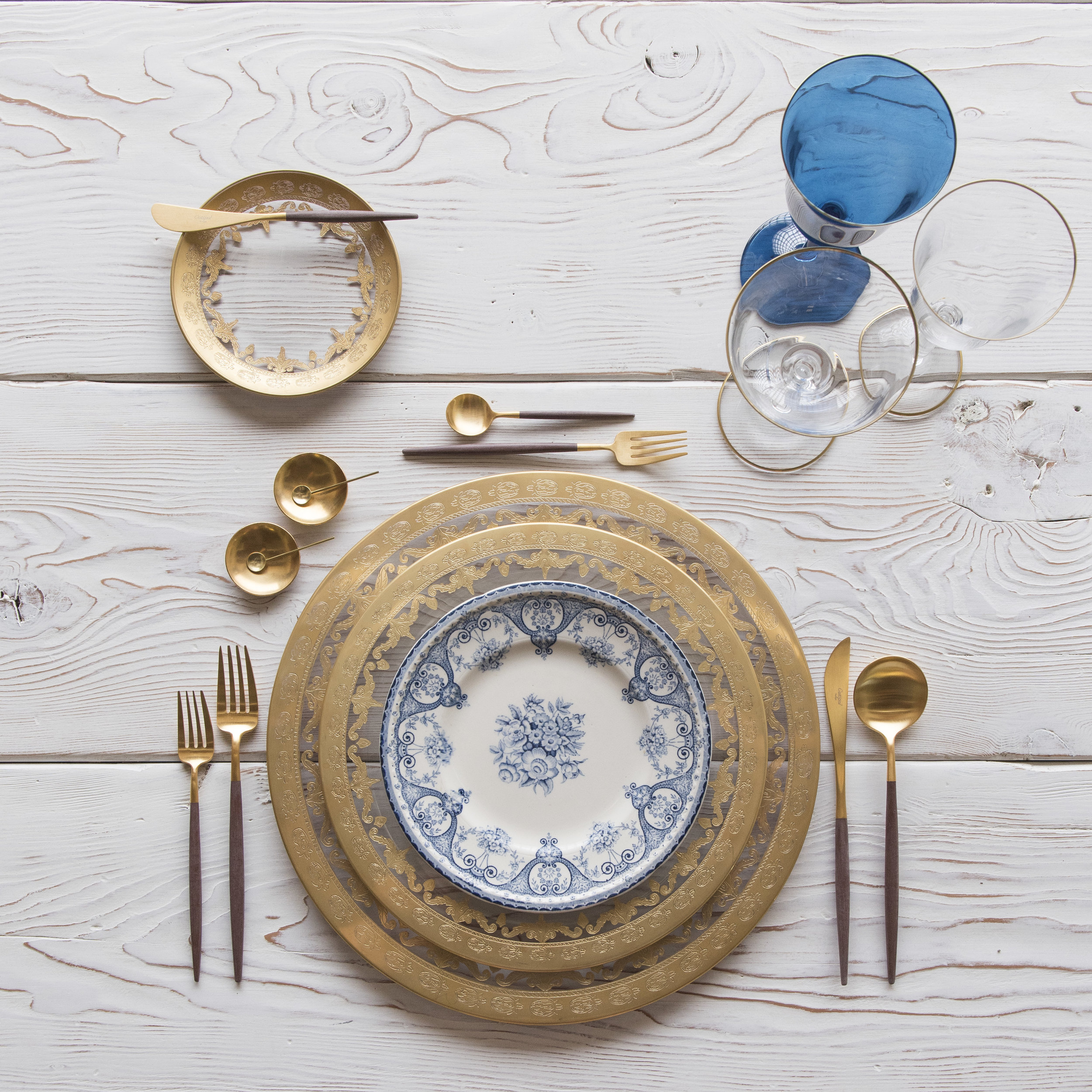 RENT: Versailles Glass Chargers/Dinnerware in 24k Gold + Blue Garden Collection Vintage China + Goa Flatware in Brushed 24k Gold/Wood + Chloe 24k Gold Rimmed Stemware + Chloe 24k Gold Rimmed Goblet in Sapphire + 14k Gold Salt Cellars + Tiny Gold Spoons   SHOP: Goa Flatware in Brushed 24k Gold/Wood + Chloe 24k Gold Rimmed Stemware + 14k Gold Salt Cellars + Tiny Gold Spoons