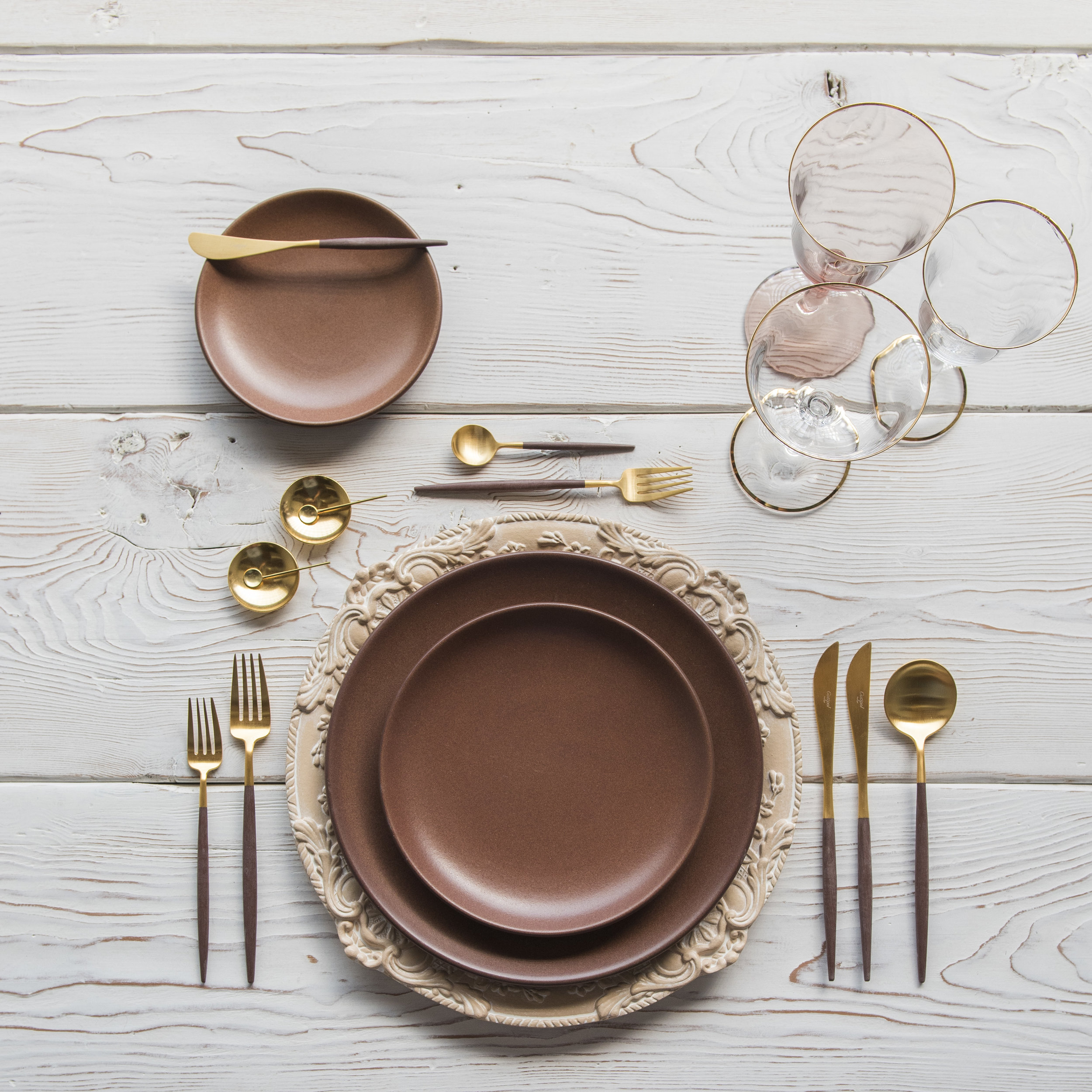RENT: Verona Chargers in Terracotta + Heath Ceramics in Redwood + Goa Flatware in Brushed 24k Gold/Wood + Chloe 24k Gold Rimmed Stemware + Chloe 24k Gold Rimmed Goblet in Blush + 14k Gold Salt Cellars + Tiny Gold Spoons   SHOP: Verona Chargers in Terracotta + Goa Flatware in Brushed 24k Gold/Wood + Chloe 24k Gold Rimmed Stemware + 14k Gold Salt Cellars + Tiny Gold Spoons
