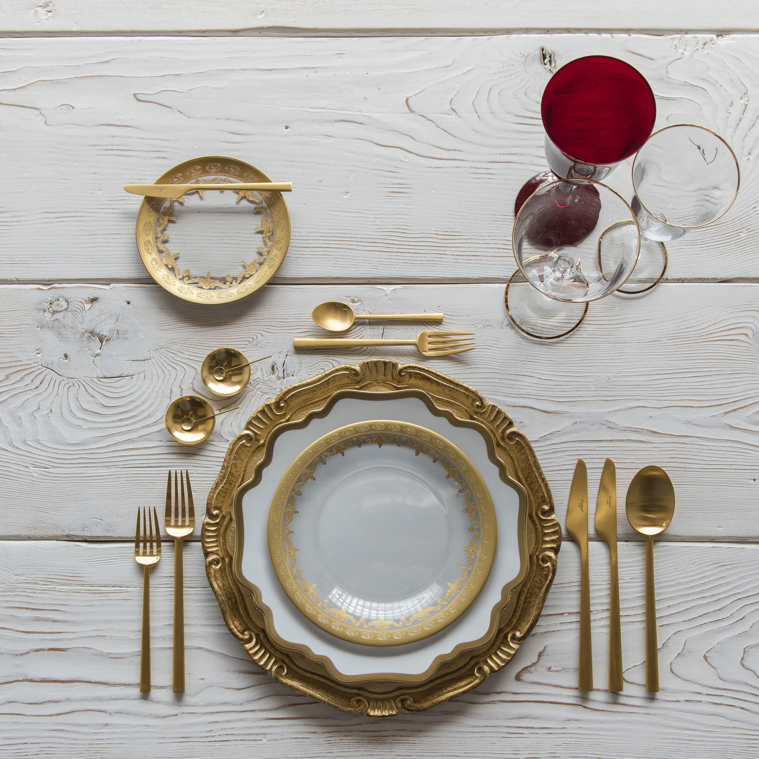 RENT: Florentine Chargers in Gold + Anna Weatherley Dinnerware in White/Gold + Versailles Glass Dinnerware in 24k Gold + Rondo Flatware in Brushed 24k Gold + Chloe 24k Gold Rimmed Stemware + Chloe 24k Gold Rimmed Goblet in Ruby + 14k Gold Salt Cellars + Tiny Gold Spoons  SHOP: Florentine Chargers in Gold + Anna Weatherley Dinnerware in White/Gold + Rondo Flatware in Brushed 24k Gold + Chloe 24k Gold Rimmed Stemware + 14k Gold Salt Cellars + Tiny Gold Spoons