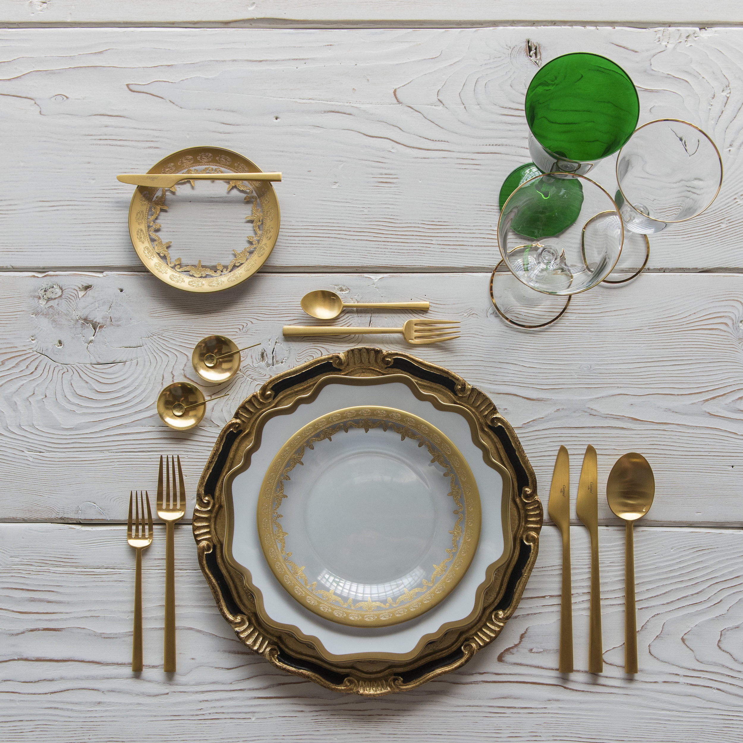 RENT: Florentine Chargers in Black/Gold + Anna Weatherley Dinnerware in White/Gold + Versailles Glass Dinnerware in 24k Gold + Rondo Flatware in Brushed 24k Gold + Chloe 24k Gold Rimmed Stemware + Chloe 24k Gold Rimmed Goblet in Emerald + 14k Gold Salt Cellars + Tiny Gold Spoons   SHOP: Florentine Chargers in Black/Gold + Anna Weatherley Dinnerware in White/Gold + Rondo Flatware in Brushed 24k Gold + Chloe 24k Gold Rimmed Stemware + 14k Gold Salt Cellars + Tiny Gold Spoons