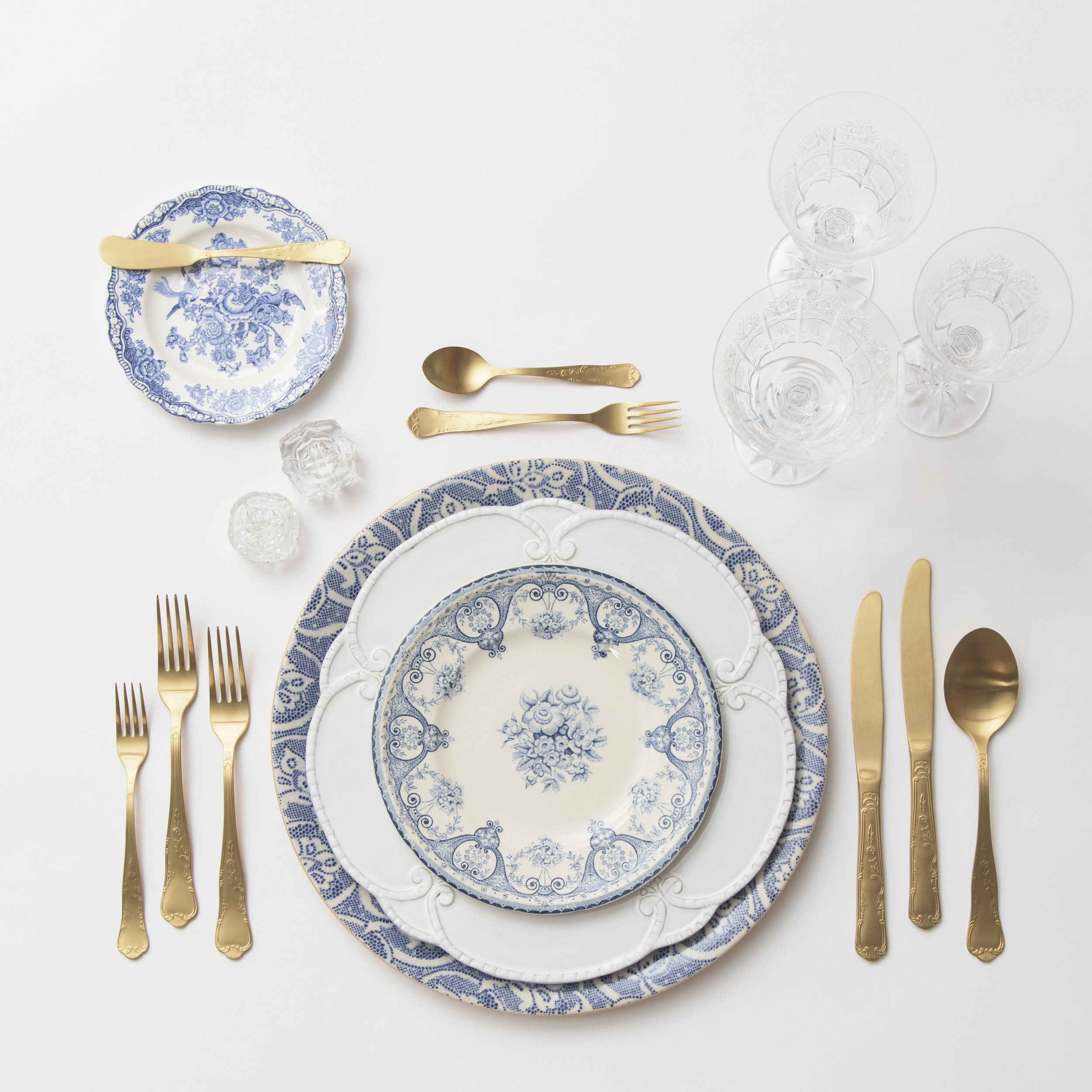 RENT: Blue Fleur de Lis Chargers + Signature Collection Dinnerware + Blue Garden Collection Vintage China + Chateau Flatware in Matte Gold + Czech Crystal Stemware + Antique Crystal Salt Cellars
