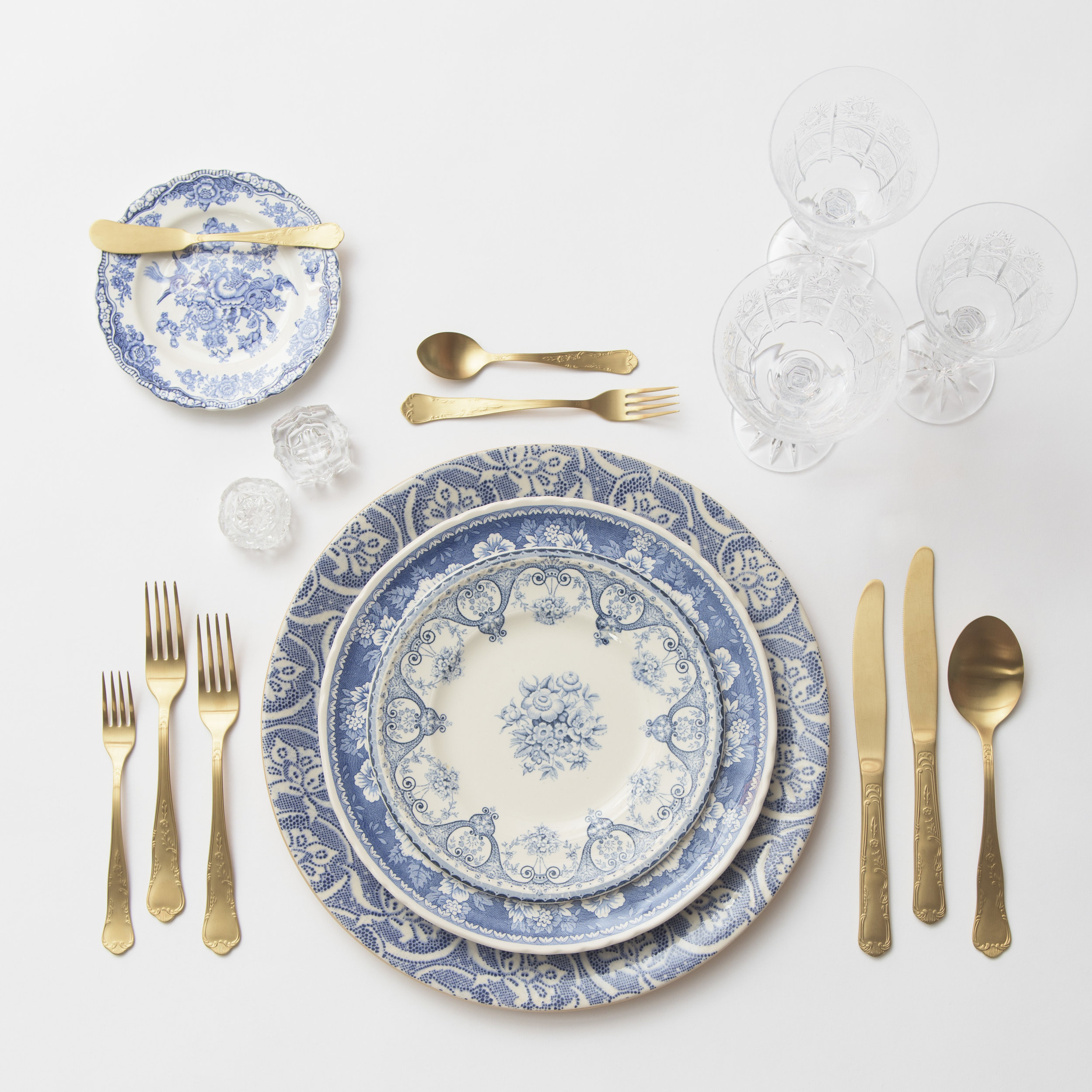 RENT: Blue Fleur de Lis Chargers + Blue Garden Collection Vintage China + Chateau Flatware in Matte Gold + Czech Crystal Stemware + Antique Crystal Salt Cellars