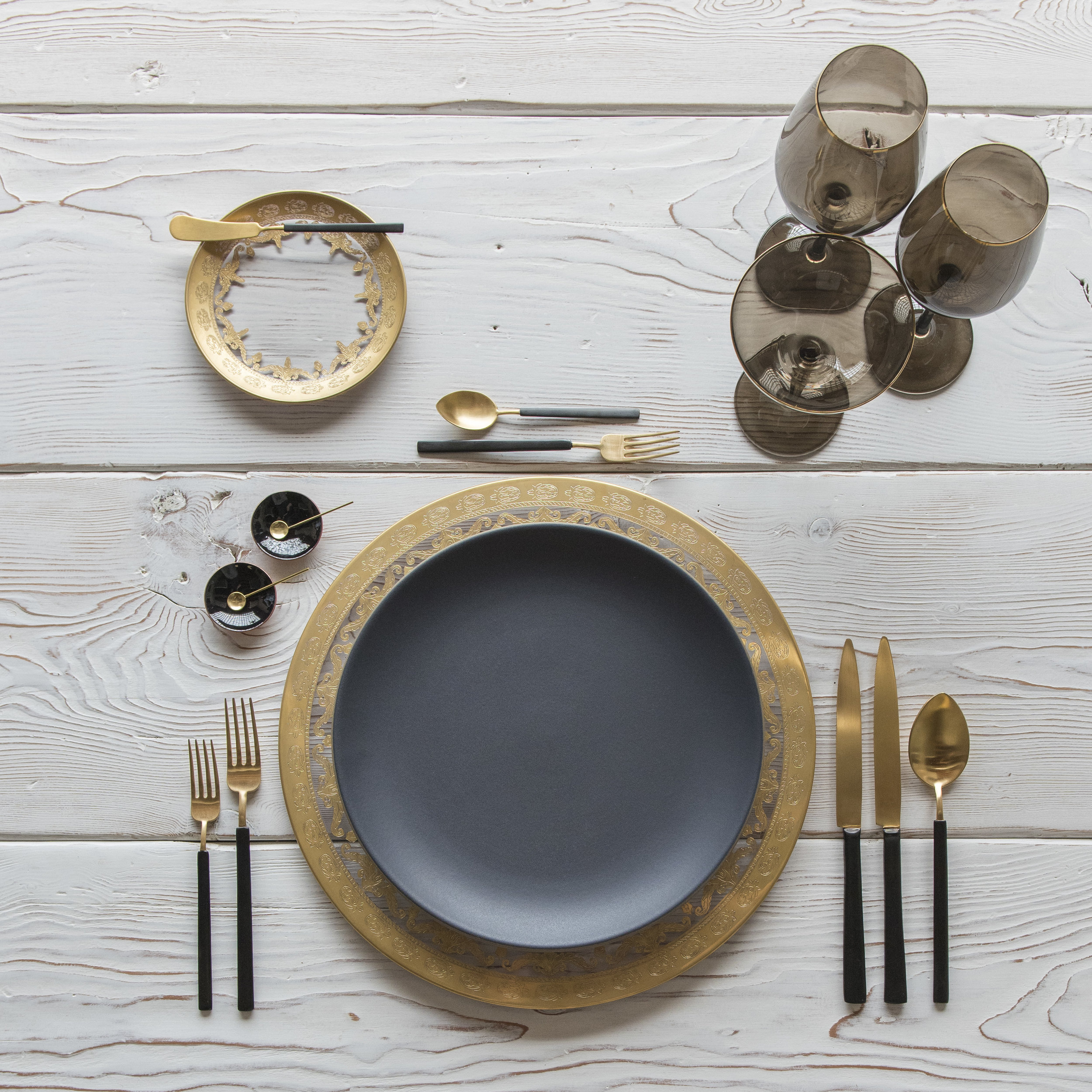 RENT: Versailles Glass Chargers/Dinnerware in 24k Gold + Heath Ceramics in Indigo/Slate + Axel Flatware in Matte 24k Gold/Black + Bella 24k Gold Rimmed Stemware in Smoke + Black Enamel Salt Cellars + Tiny Gold Spoons  SHOP: Bella 24k Gold Rimmed Stemware in Smoke + Black Enamel Salt Cellars + Tiny Gold Spoons