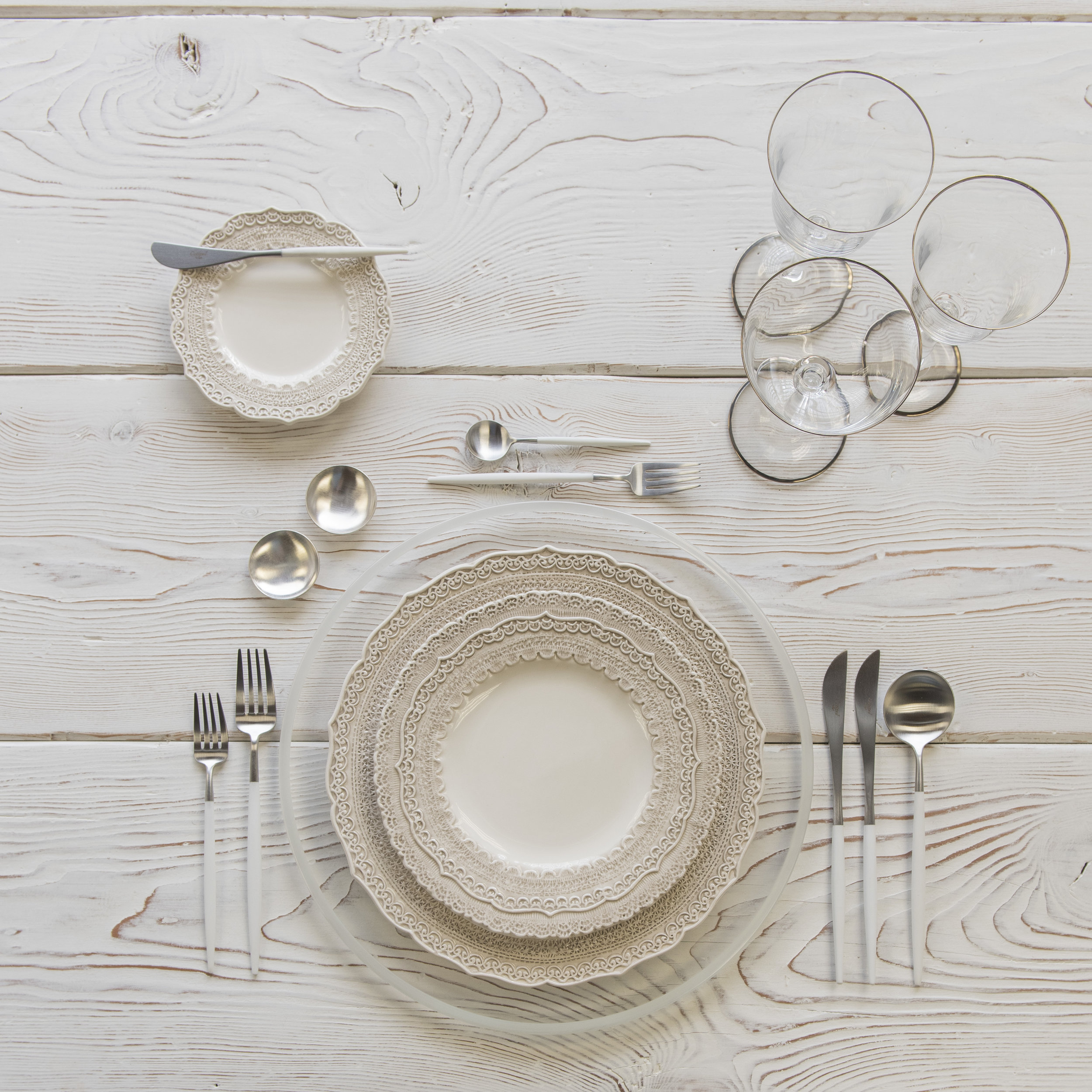 RENT: Halo Glass Chargers in Pearl + Lace Dinnerware in White + Goa Flatware in Brushed Steel/White + Chloe Platinum Rimmed Stemware + Silver Salt Cellars  SHOP:Halo Glass Chargers in Pearl + Goa Flatware in Brushed Steel/White + Chloe Platinum Rimmed Stemware