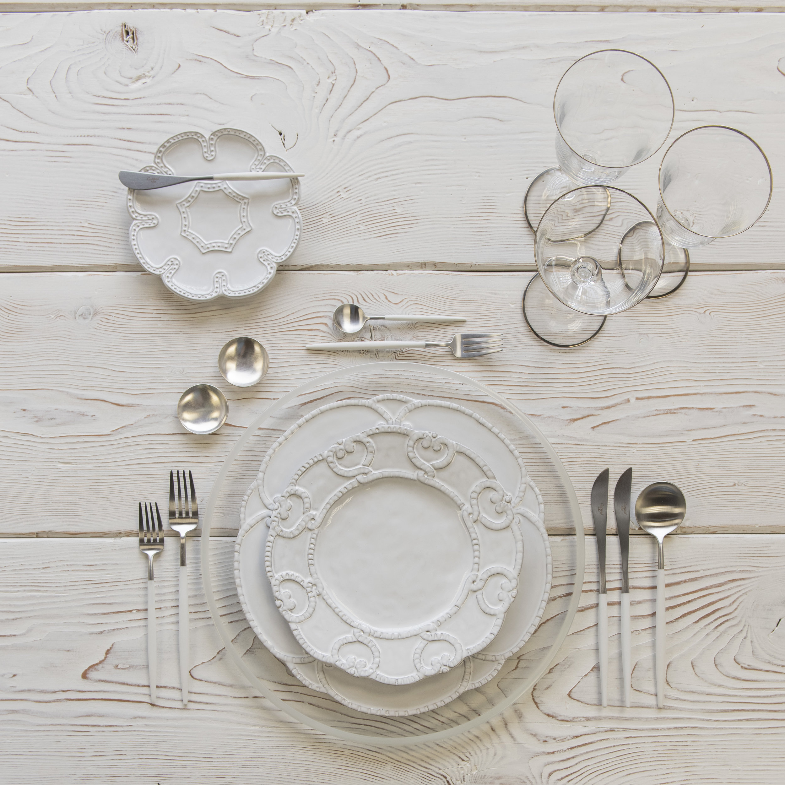 RENT: Halo Glass Chargers in Pearl + Signature Collection Dinnerware + Goa Flatware in Brushed Steel/White + Chloe Platinum Rimmed Stemware + Silver Salt Cellars  SHOP:Halo Glass Chargers in Pearl + Goa Flatware in Brushed Steel/White + Chloe Platinum Rimmed Stemware