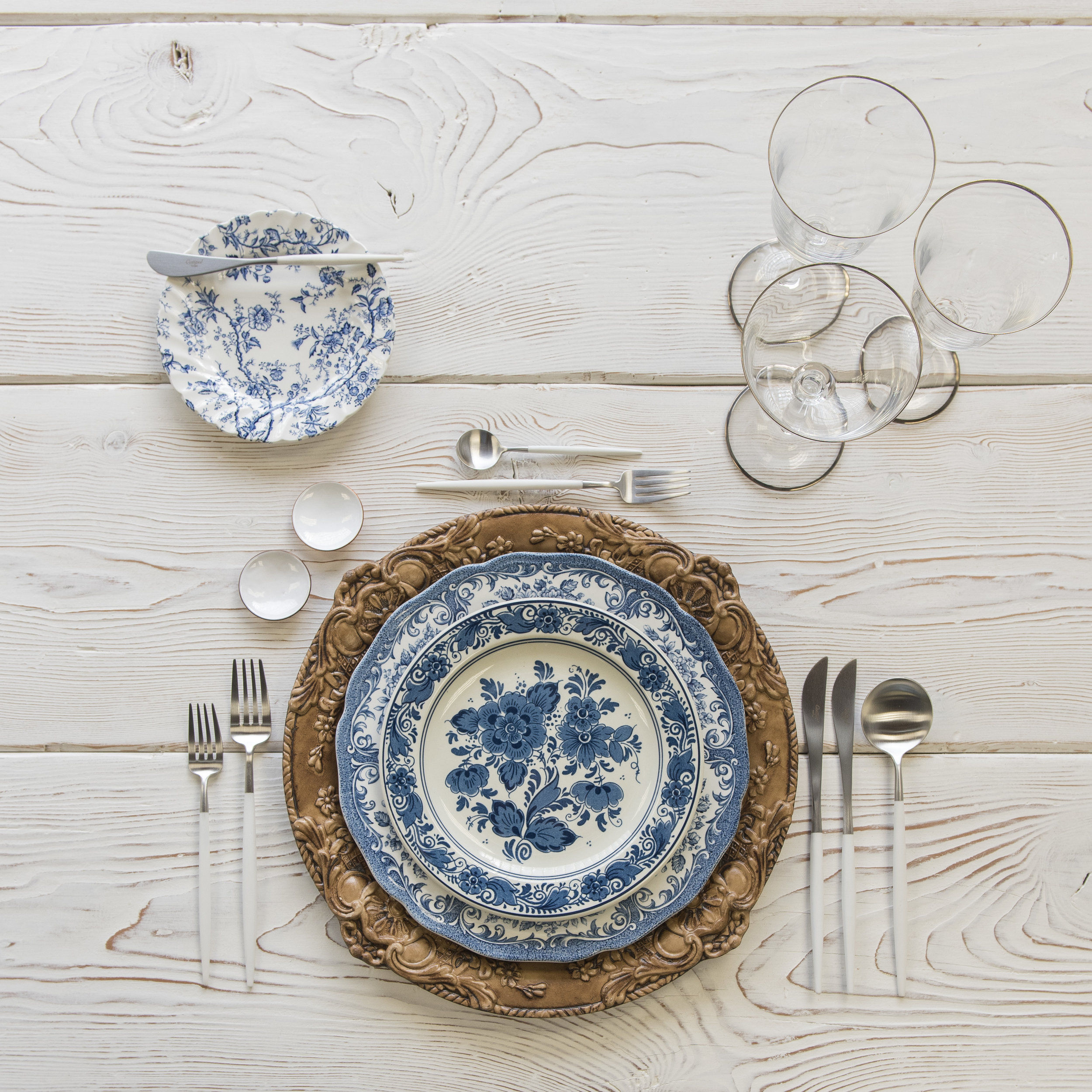 RENT: Verona Chargers in Walnut + Blue Garden Collection Vintage China + Goa Flatware in Brushed Steel/White + Chloe Platinum Rimmed Stemware + White Enamel Salt Cellars  SHOP: Verona Chargers in Walnut + Goa Flatware in Brushed Steel/White + Chloe Platinum Rimmed Stemware + White Enamel Salt Cellars