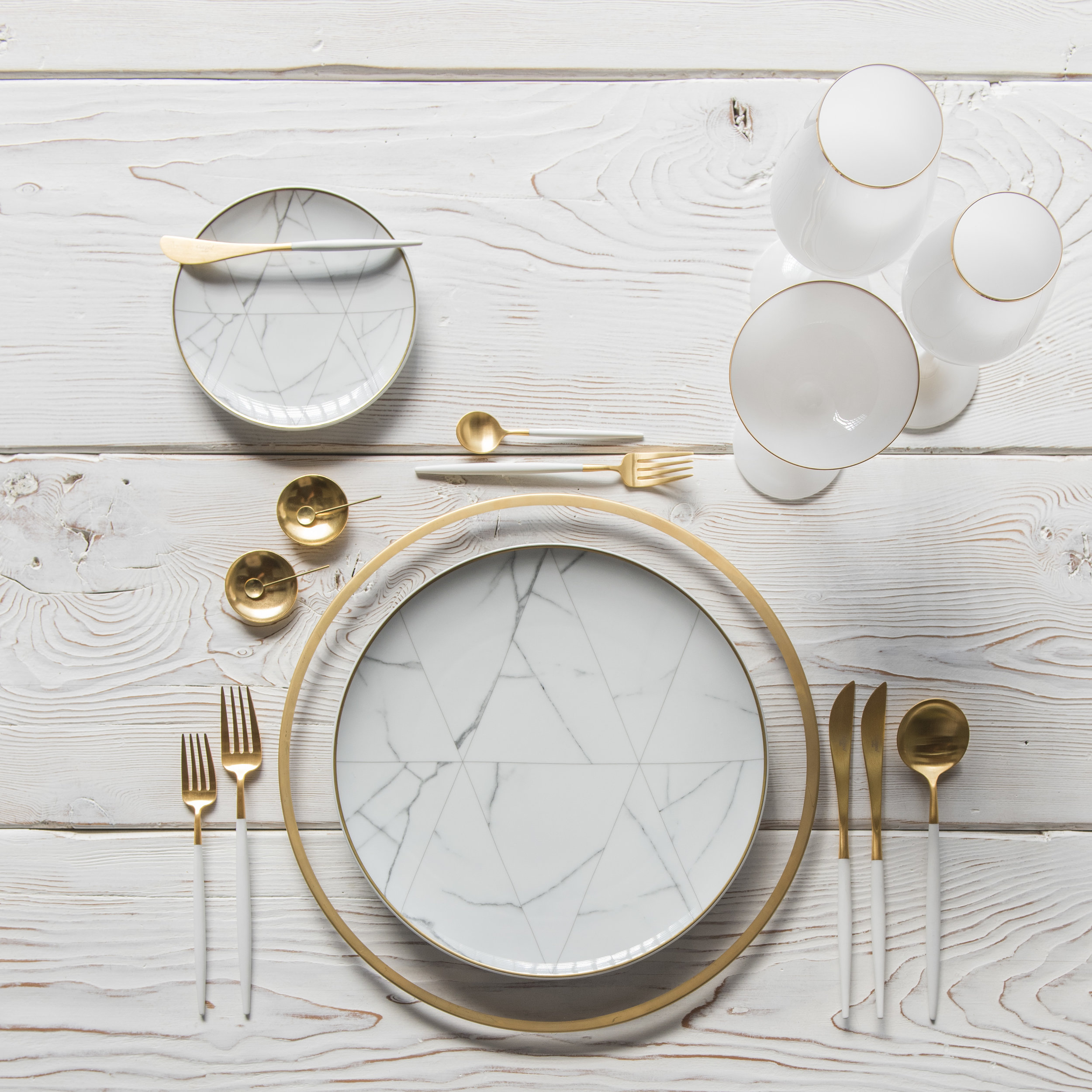 RENT: Halo Glass Chargers in 24k Gold + Carrara Dinnerware + Goa Flatware in Brushed 24k Gold/White +14k Gold Salt Cellars + Tiny Gold Spoons  SHOP:Halo Glass Chargers in 24k Gold + Carrara Dinnerware + Goa Flatware in Brushed 24k Gold/White + Bella 24k Gold Rimmed Stemware in White + 14k Gold Salt Cellars + Tiny Gold Spoons
