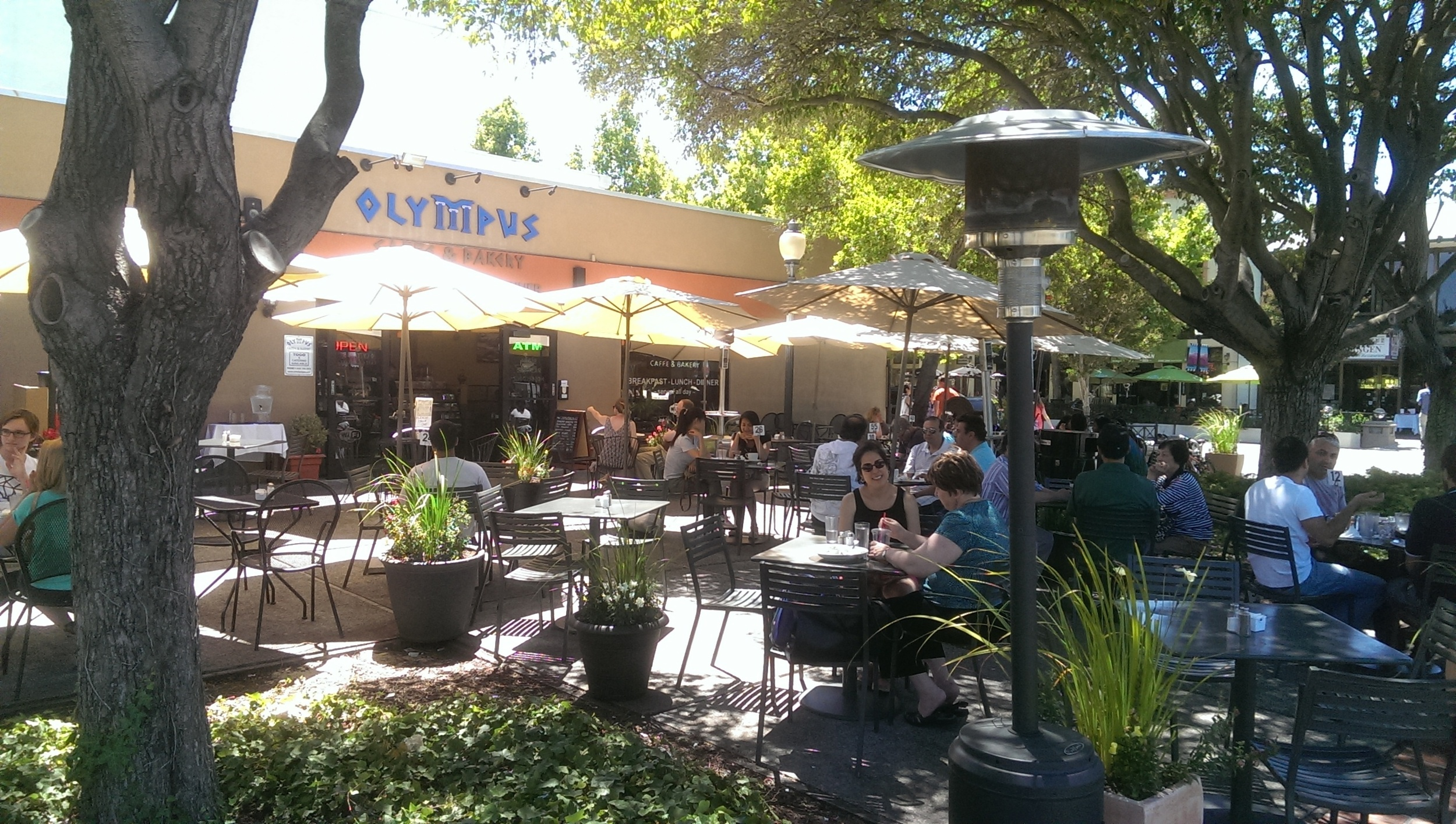 "The patio at the Olympus Cafe, just across the street from Mountain View's train station, one of many reasons my town should be more than a ""transfer point"" for Super Bowl 50 fans."