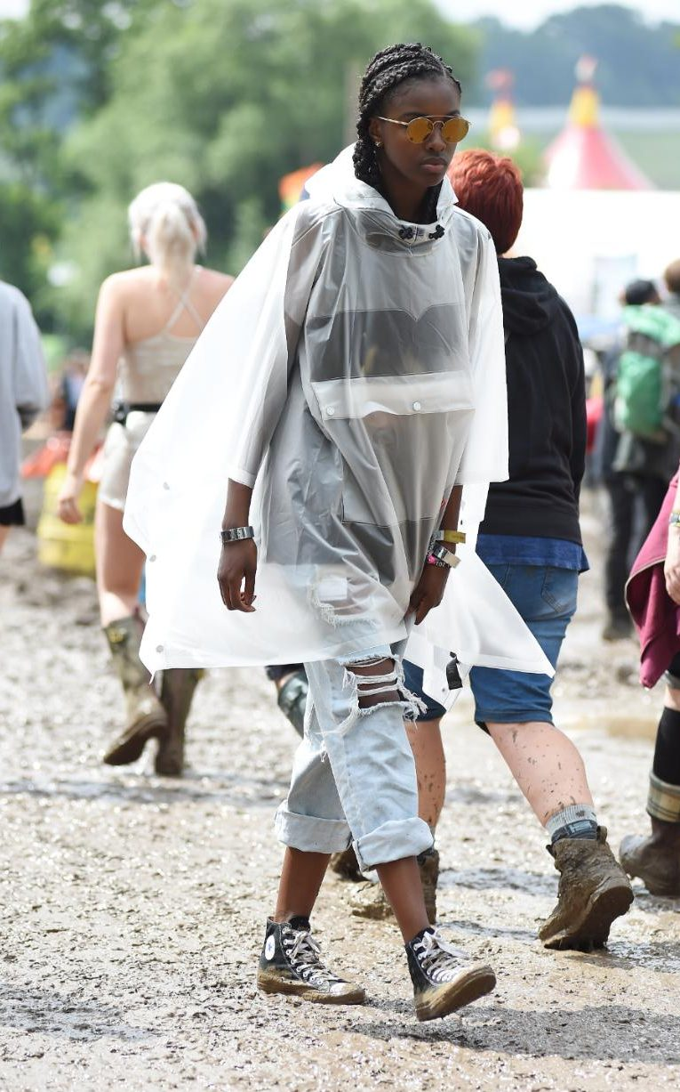 Model Leomie Anderson wearing an awesome transparent rain coat paired with some classic BF jeans and converse