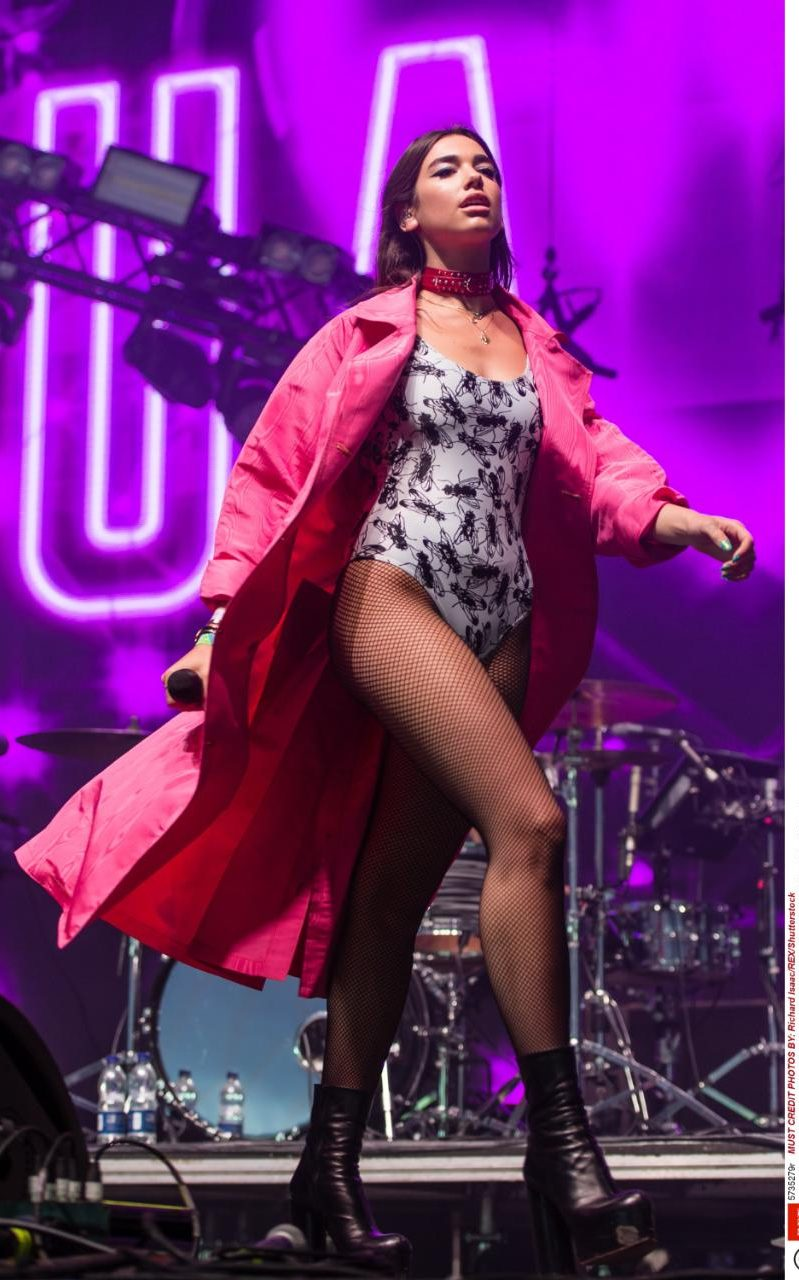 My actual dream queen Dua Lipa wearing a sick bodysuit paired with probably the coolest pink coat and OF COURSE! Fishnets (did she read my trends post on them?)