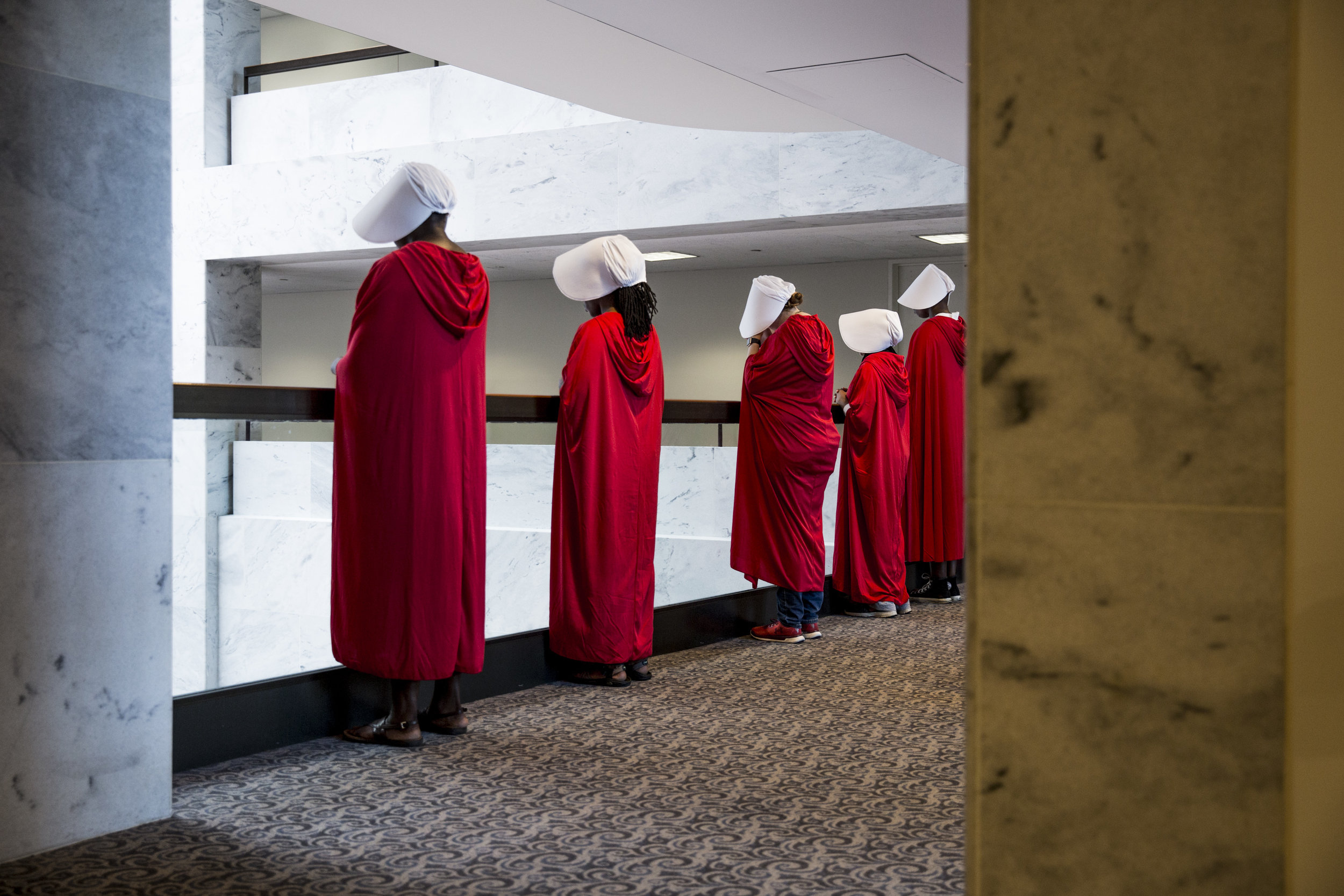 Protestors dressed as handmaids demonstrate in the hallways of the Hart Senate Building before the start of the second day of hearings for the confirmation of Supreme Court Nominee Brett Kavanaugh on September 5th, 2018