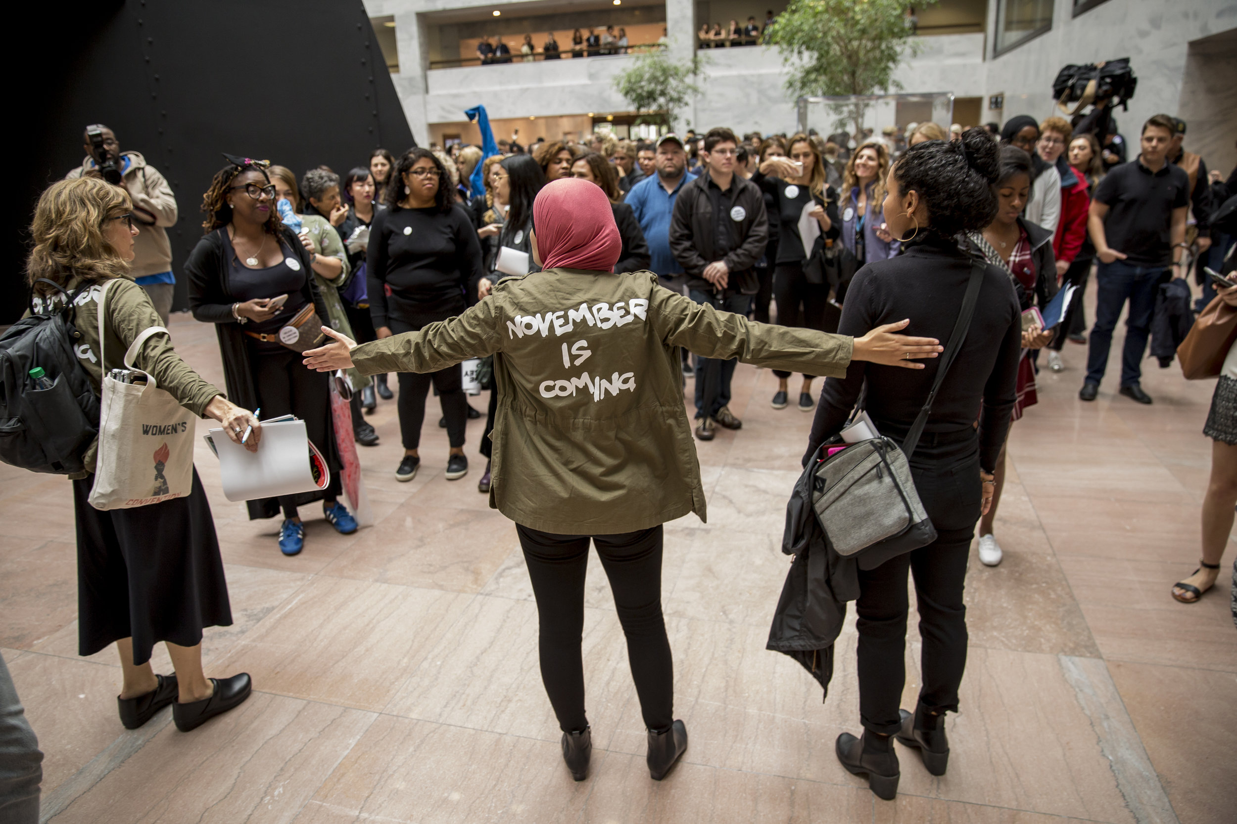 "Linda Sarsour directs activists participating in the demonstration organized by the Women's March titled ""Cancel Kavanaugh: We Believe Christine"" in the Hart Senate Office Building on September 27th, 2018"