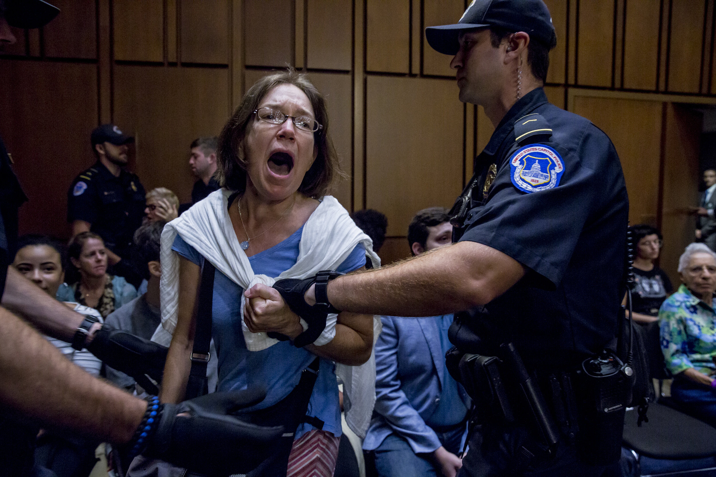 Protestors are removed from Senate Judiciary Committee hearing on September 5th, 2018