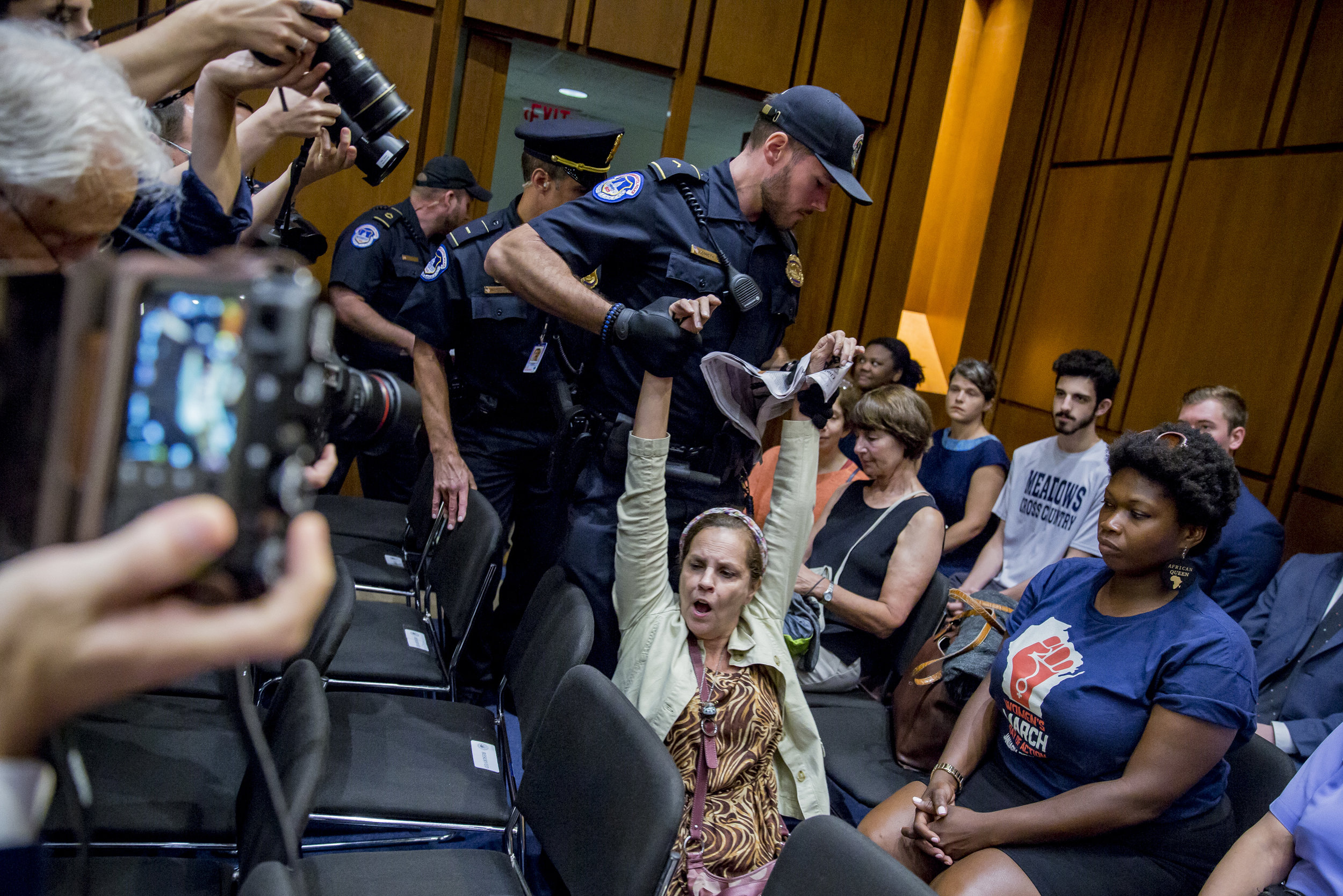 A protestor is removed from Senate Judiciary Committee hearing on September 5th, 2018
