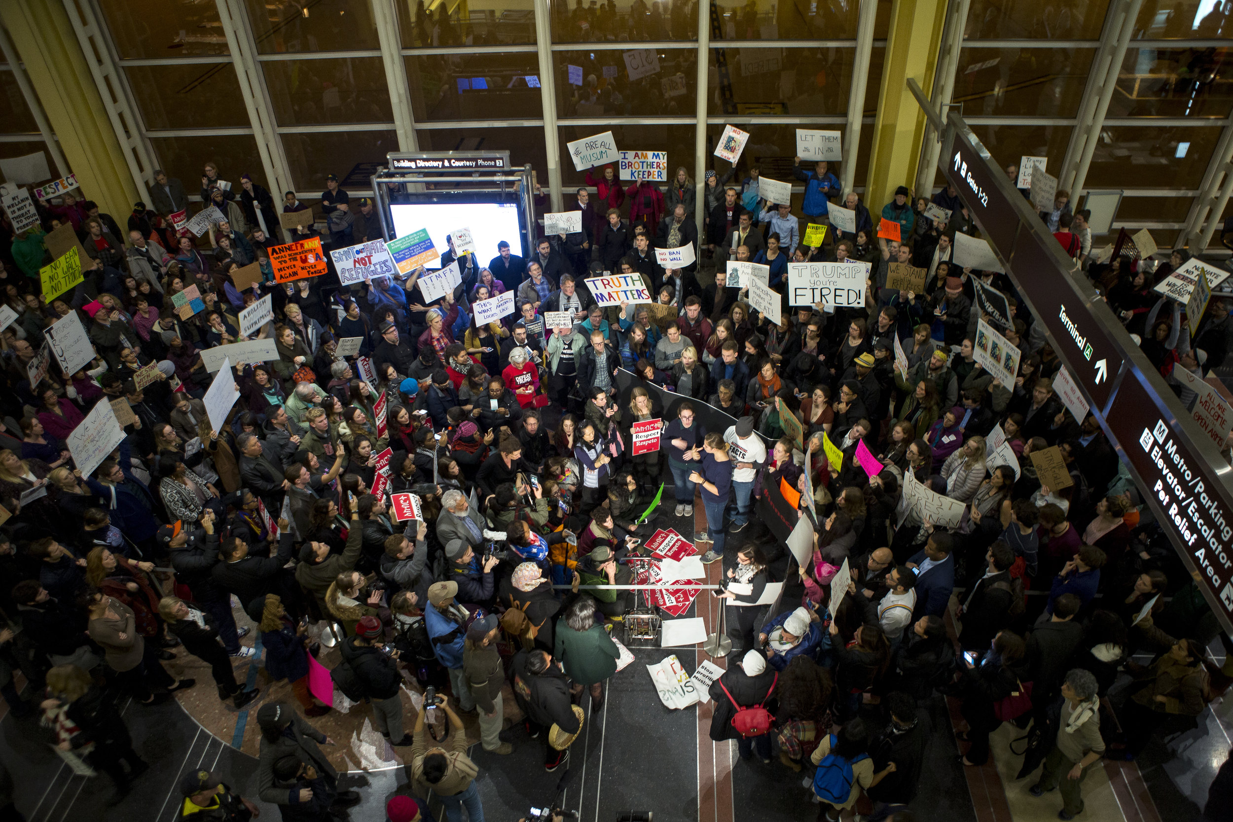 "Protesters gather at the Ronald Reagan Washington National Airport to protest against President Trump's ""Muslim Ban"" on February 1st 2017."