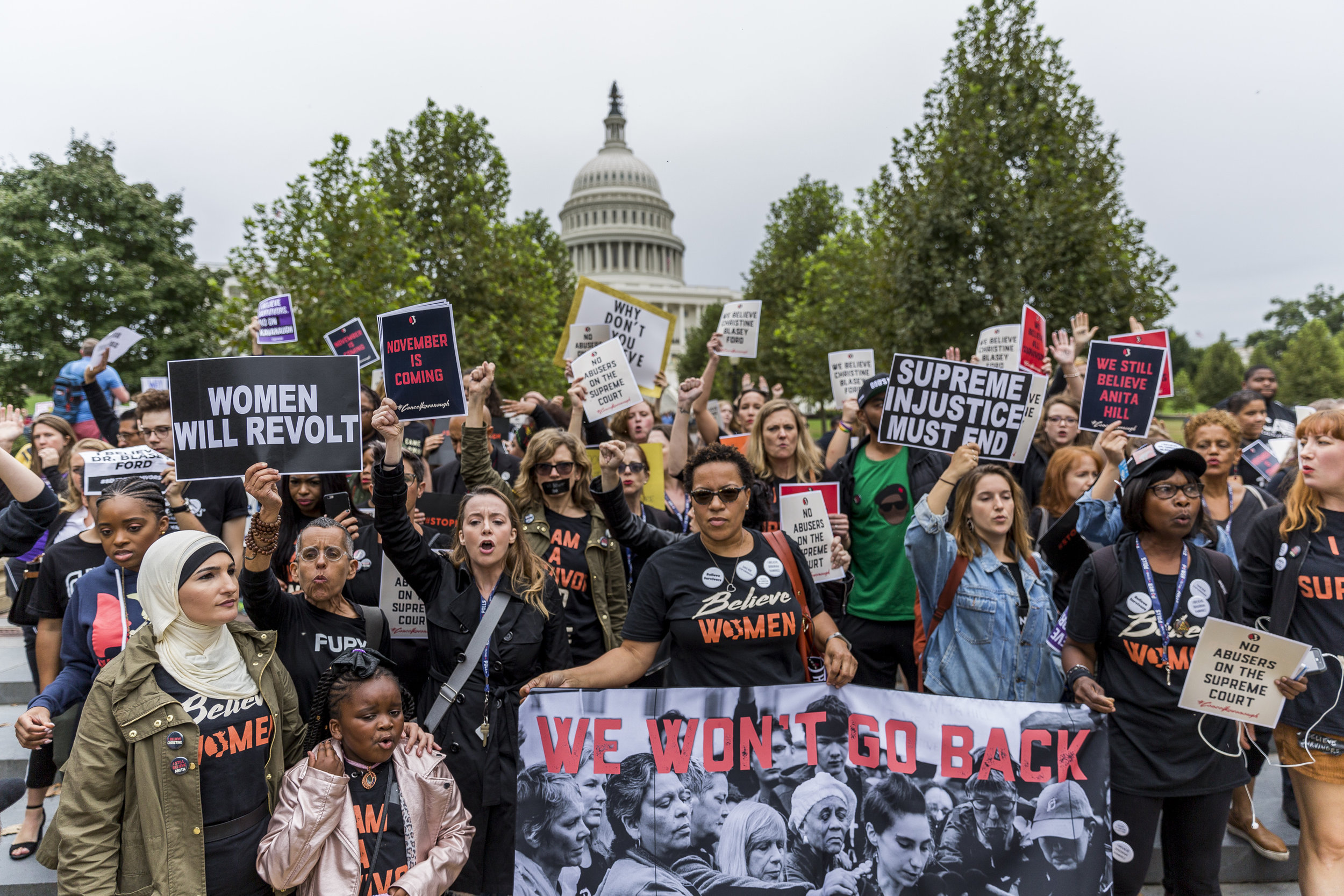Protesters against the confirmation of Supreme Court nominee Brett Kavanaugh march to the reflecting pool in front of the United States Capitol on September 27th, 2018