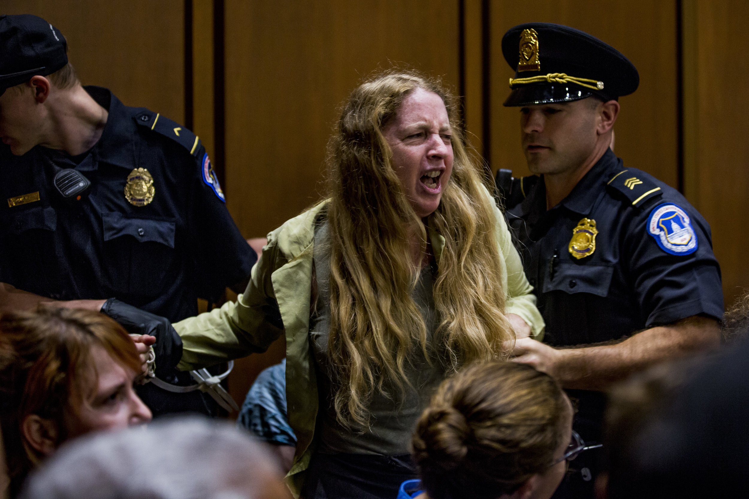Protestors are removed from Senate Judiciary Committee hearing on September 4th, 2018