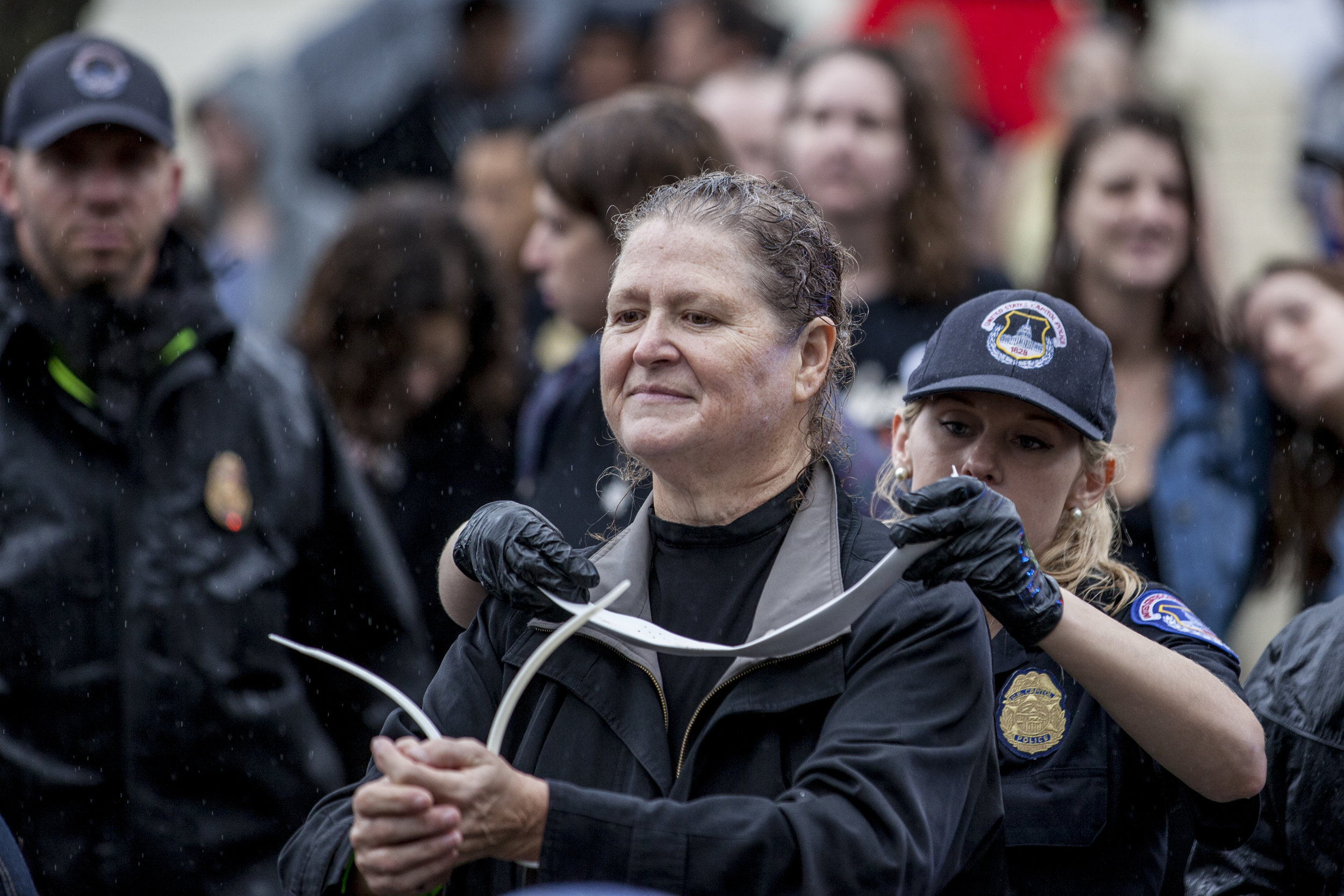 A Unitarian Church pastor's collar is removed by the police as she gets arrested outside the Supreme Court on September 27th, 2018