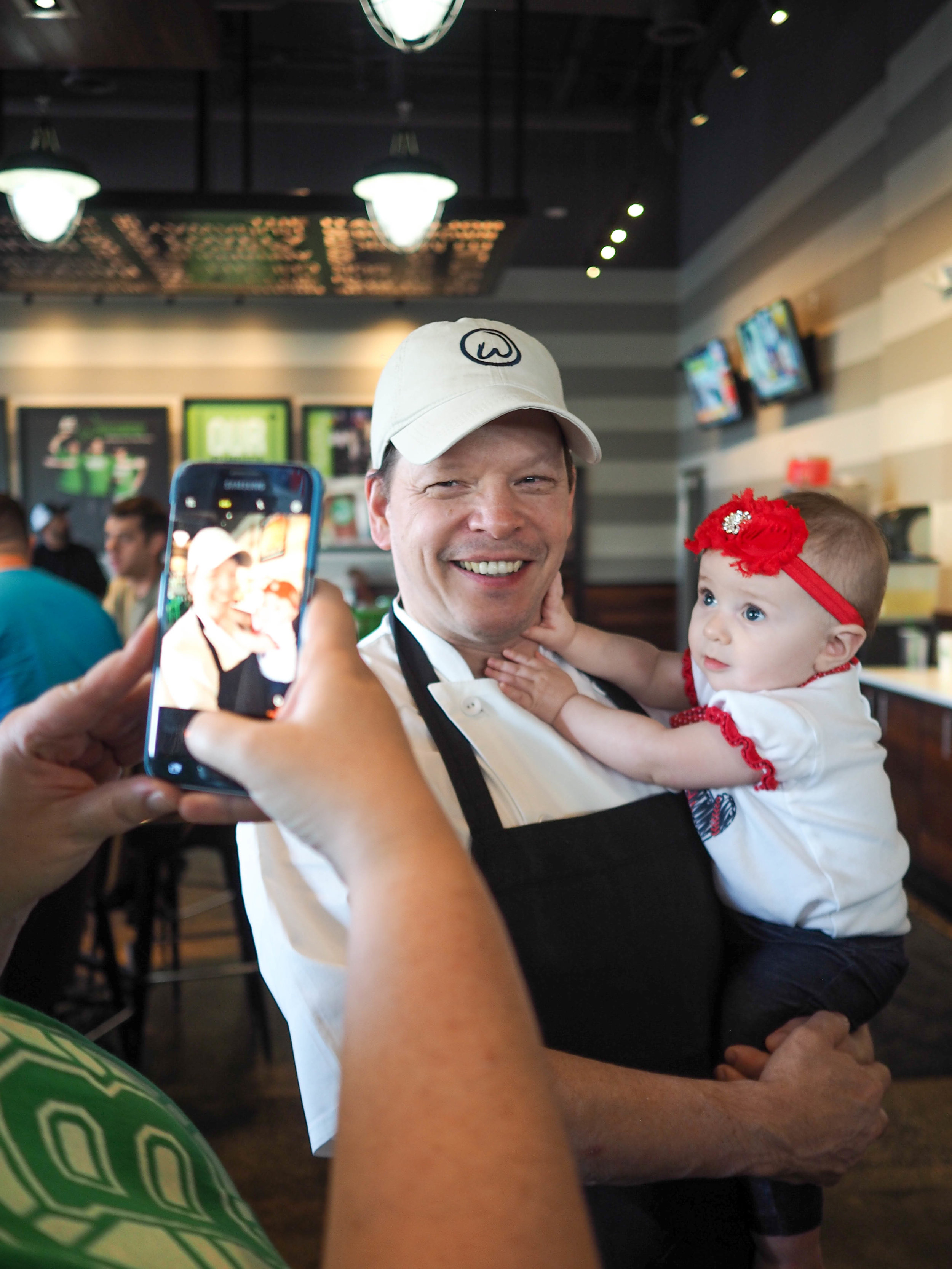Executive Chef Paul Wahlburg poses with baby