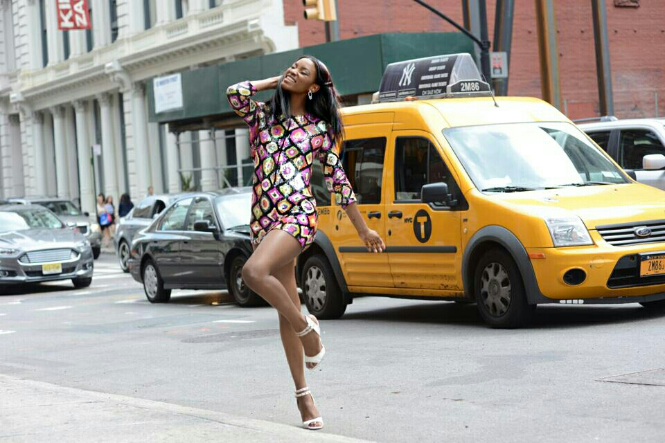 70s fashion without the boots and headband. Still dancing on New York streets.