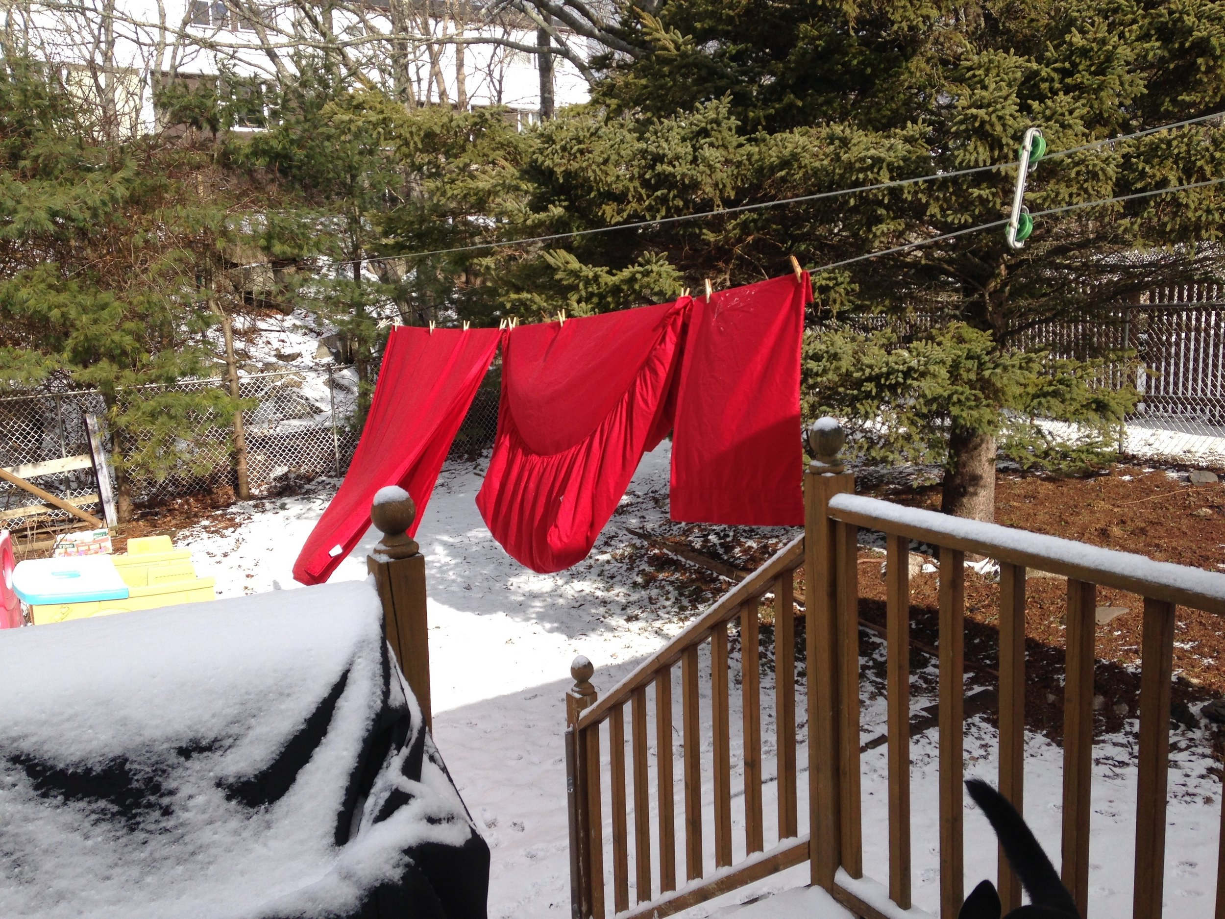 Clean bed sheet on clothes line in the spring