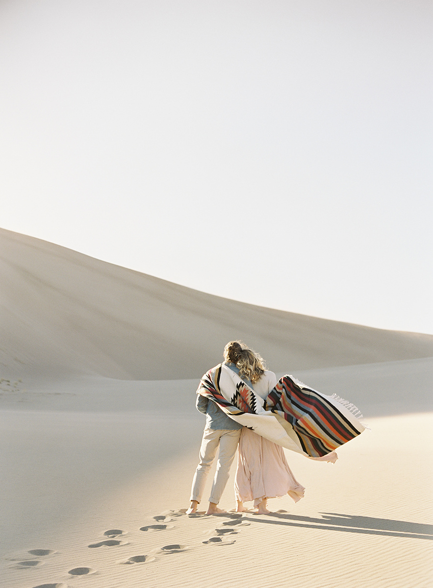 sun soaked sand dunes engagement on film