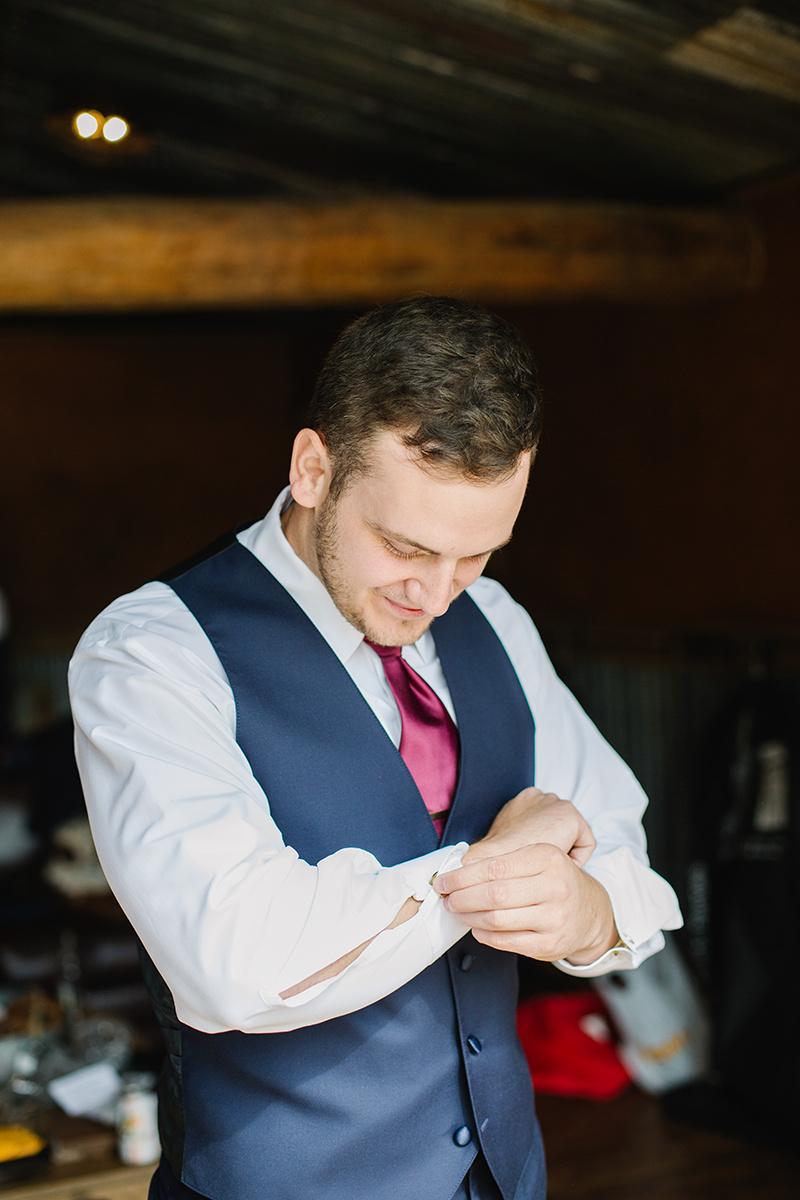 groom getting ready on film
