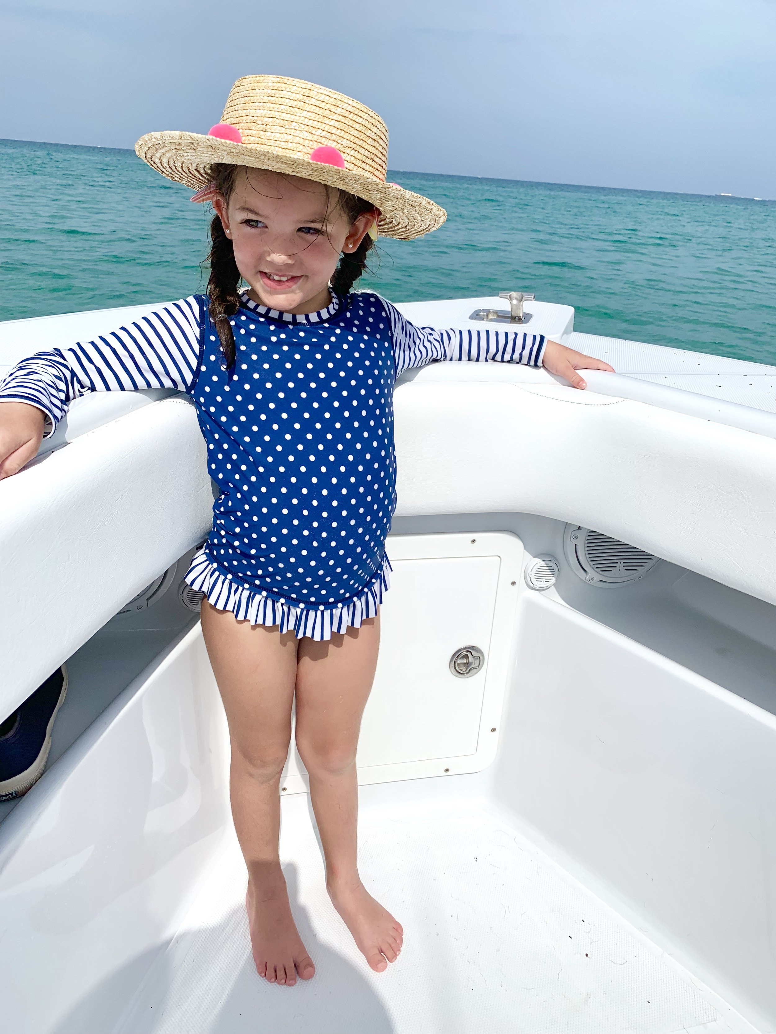 We love our Ruffle Butts rash guard sets and get them at Mother Goose Miami. I take sun prevention seriously these days.