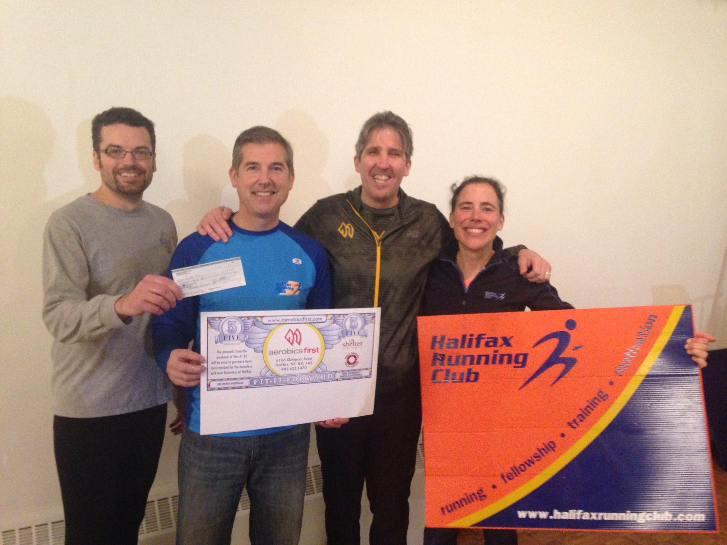 Nick McBride, Mark Pothier and Marie-Claude Gregoire present cheque to Luke MacDonald.