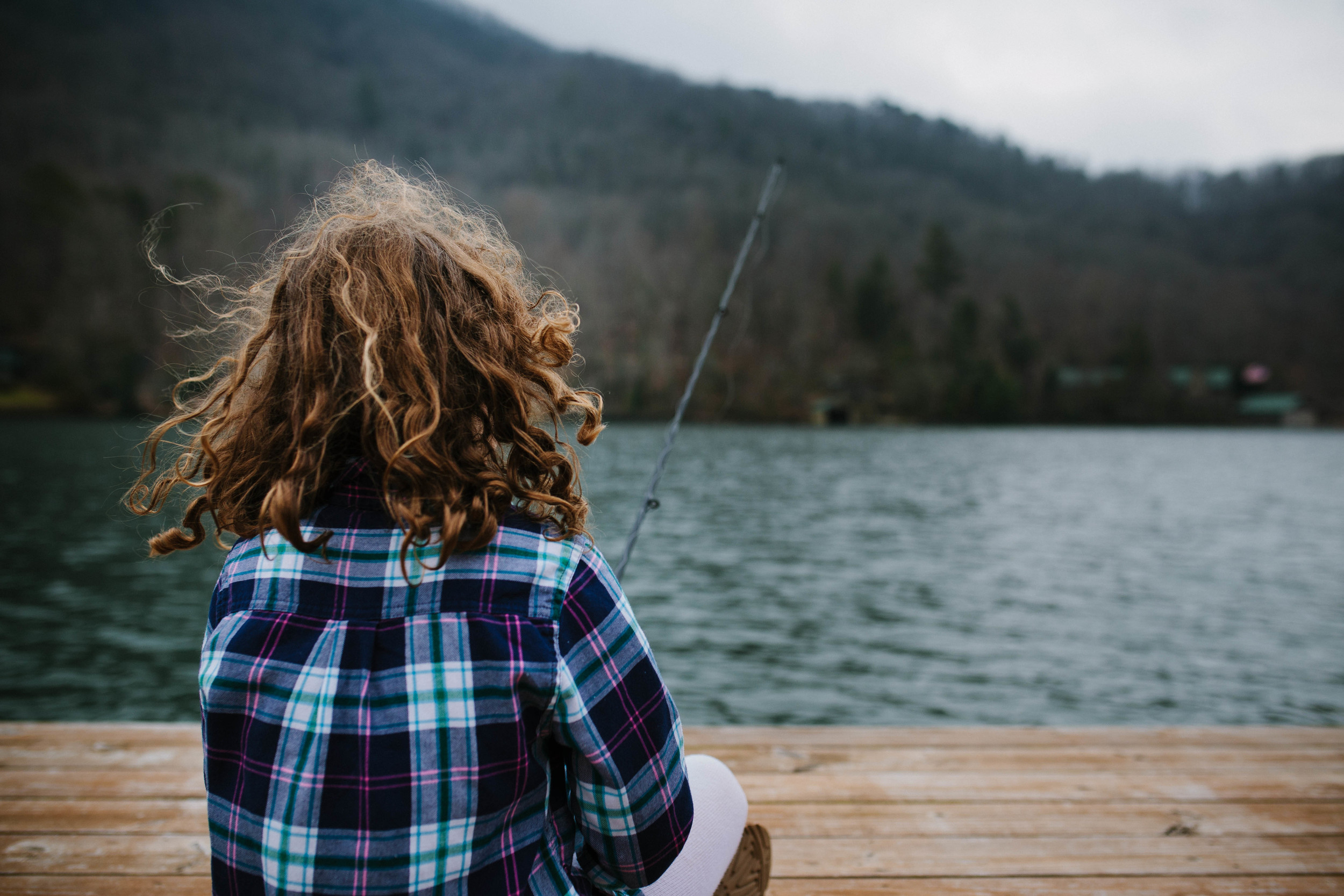 Close up image of girl fishing from behind