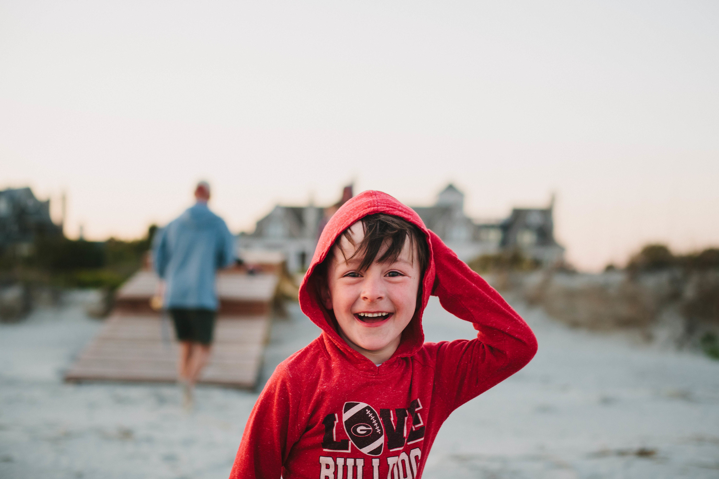 Image of boy smiling at the camera at the beach