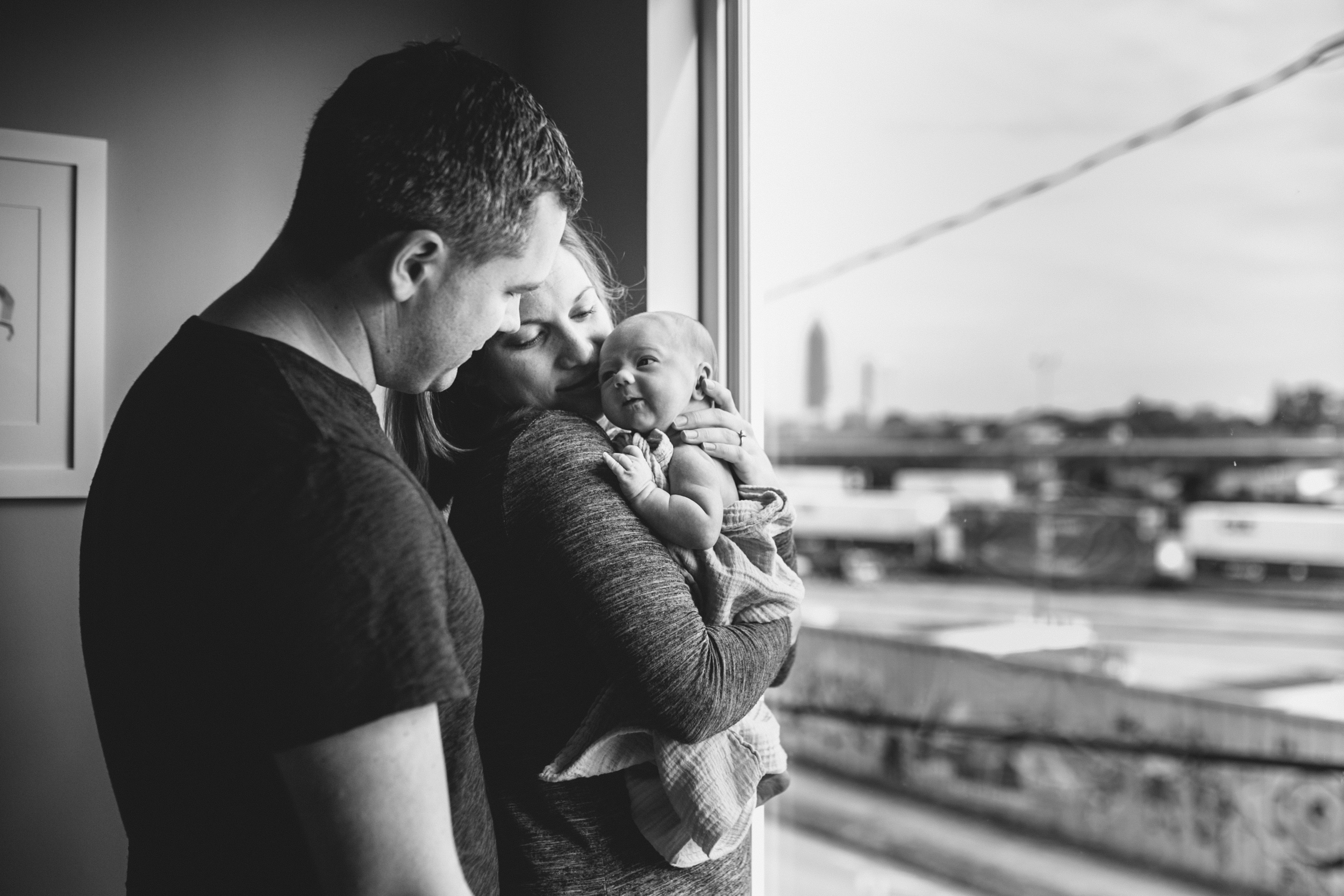 image of newborn looking at father from at home atlanta newborn documentary photography session