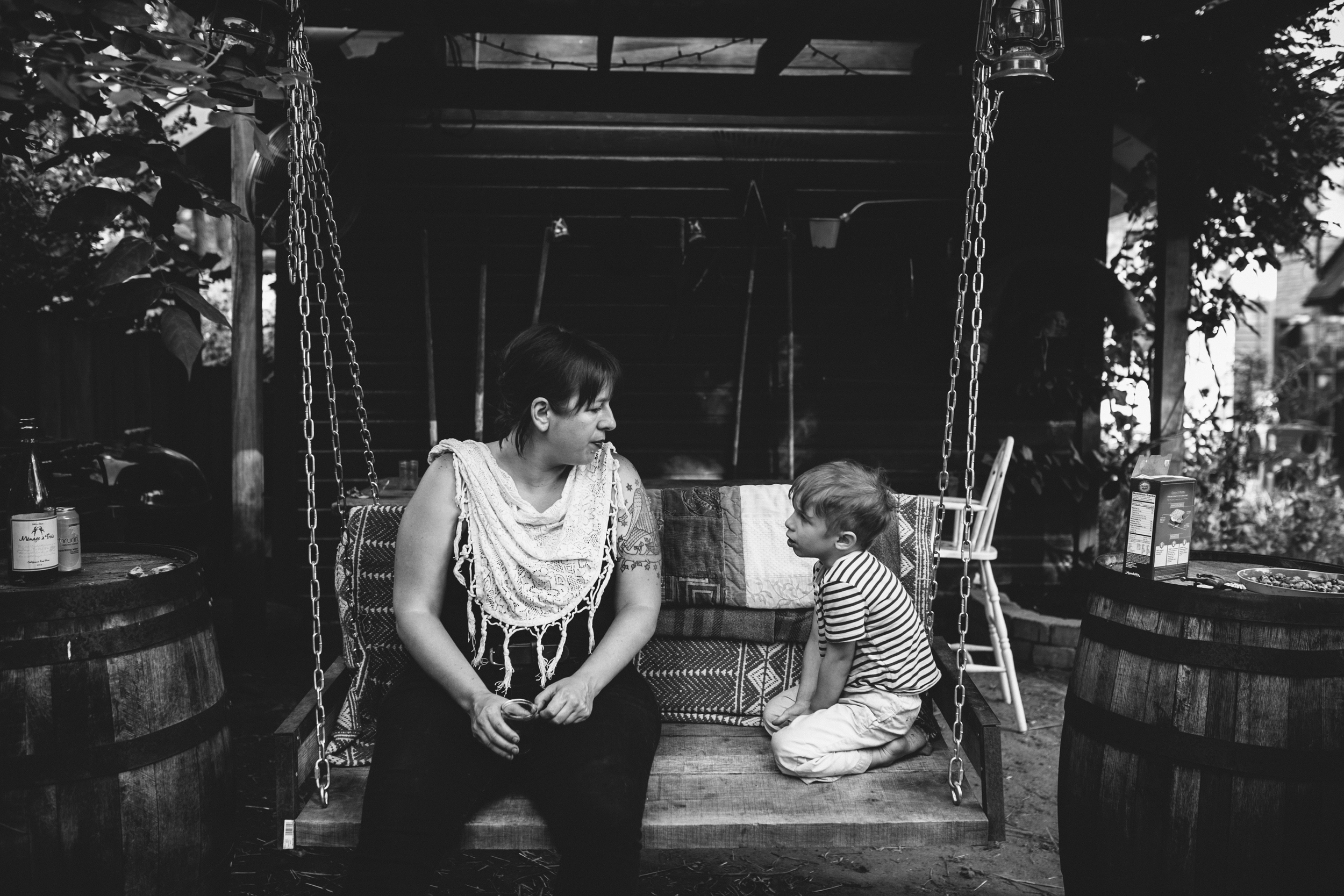 image from family documentary session of mother and son sitting on swing looking at each other