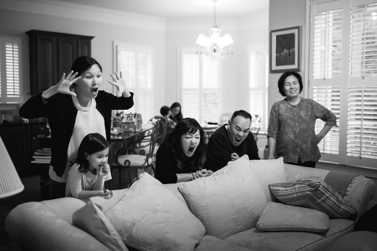 family roars at child not in the frame from a family documentary photography session in atlanta