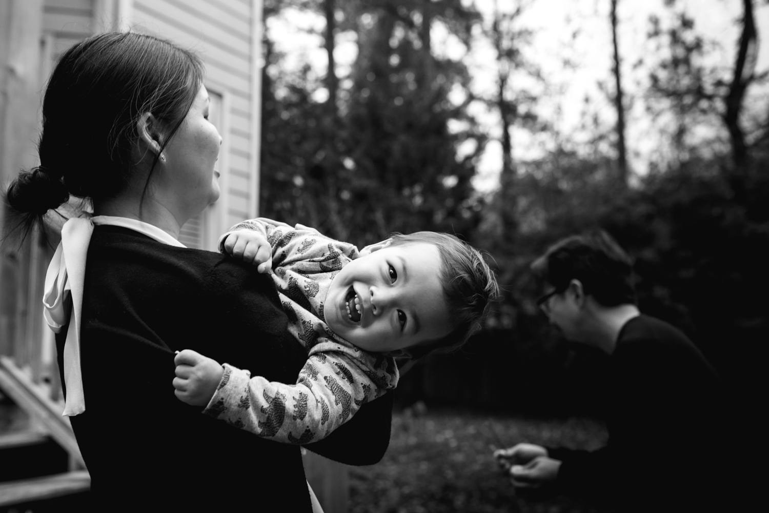 baby laughs while being held by mother from family documentary photography session atlanta