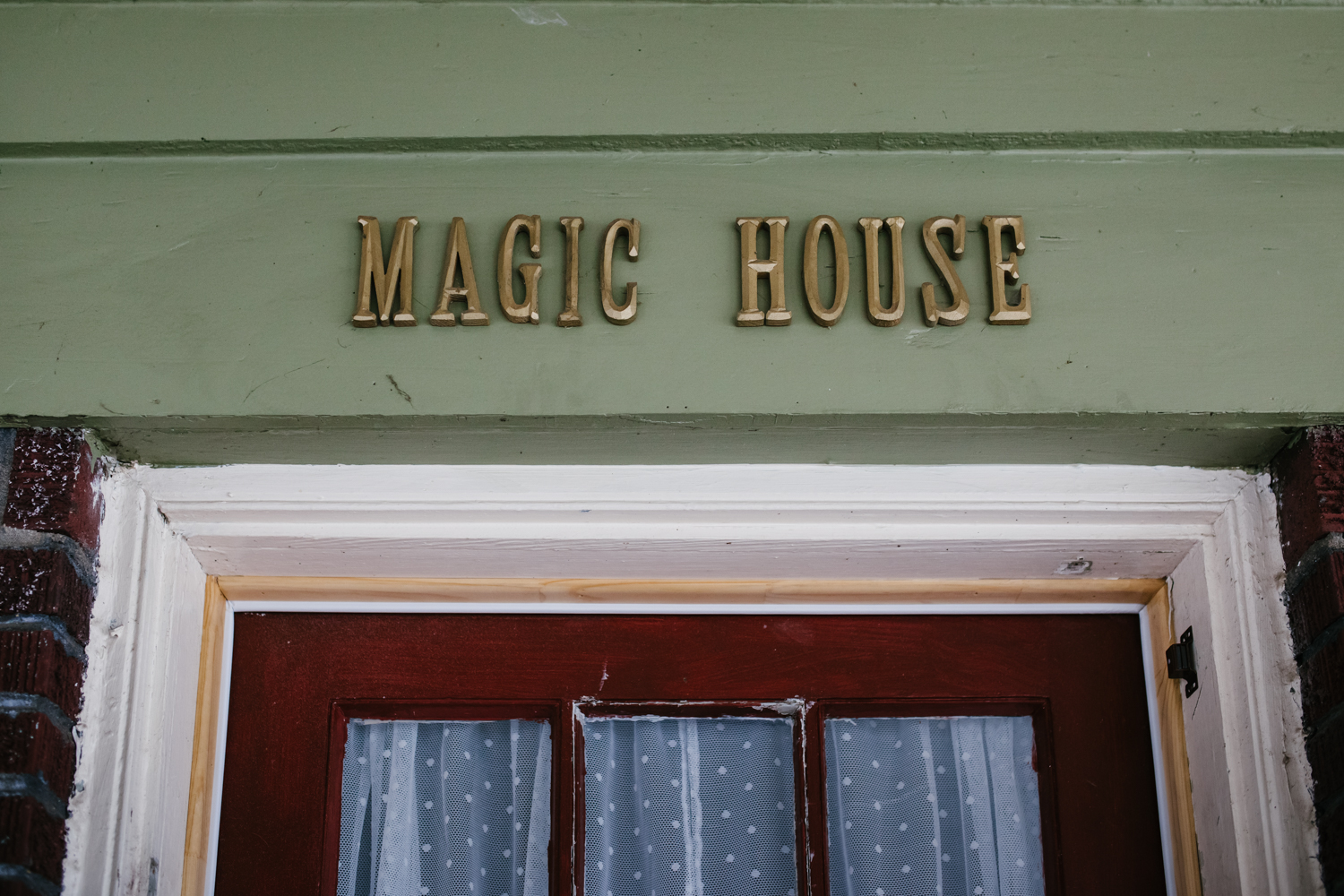 image of the top of a door frame with the words magic house on top from documentary family session in atlanta