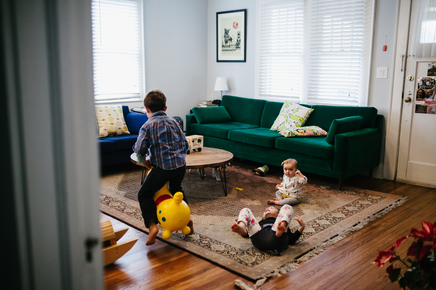 three children playing in the living room from a family documentary photography session in atlanta