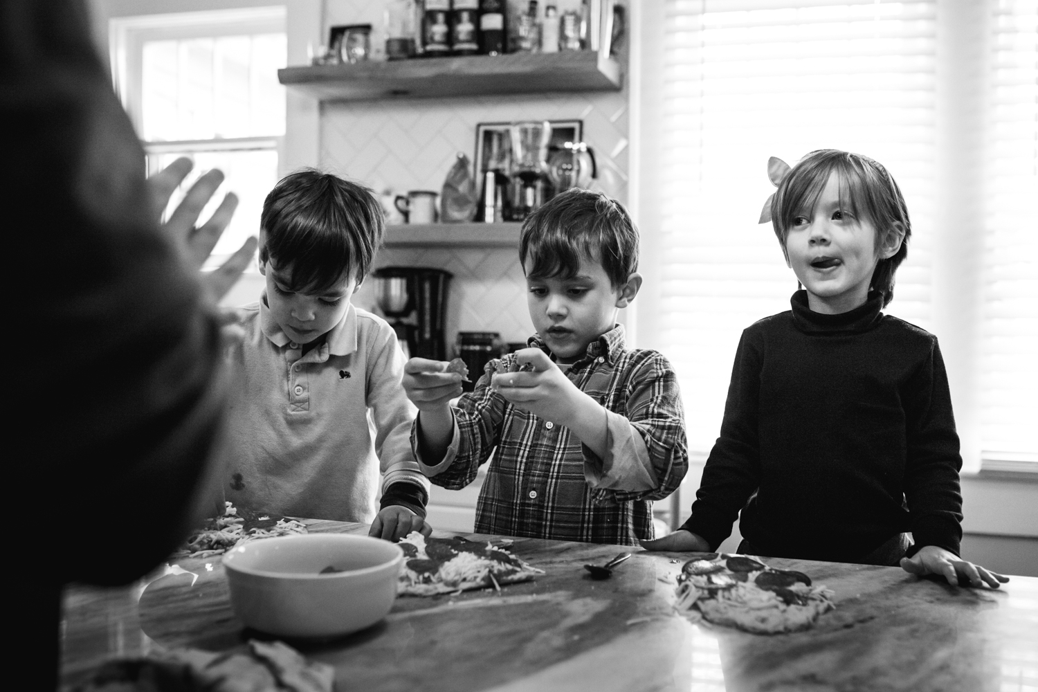 three kids making pizza from a family documentary photography session in atlanta