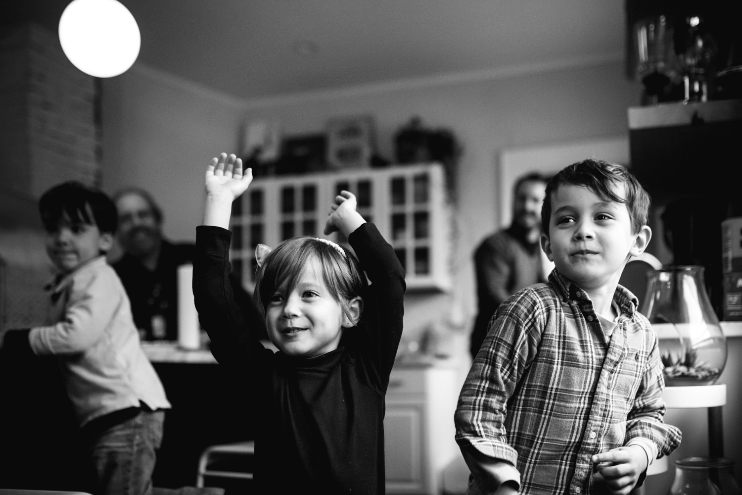 kids dancing in the kitchen from family documentary photography session in atlanta