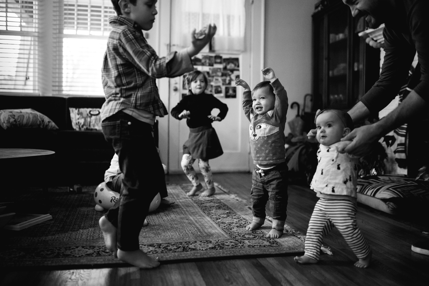 kids dancing in the living room from family documentary photography session in atlanta