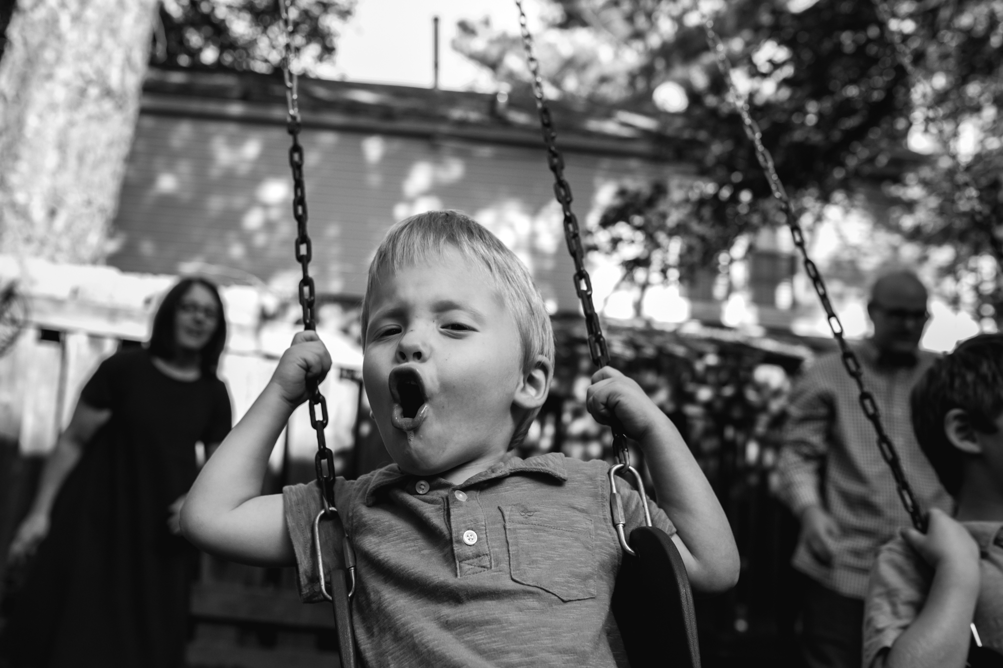 Boy on a swing singing