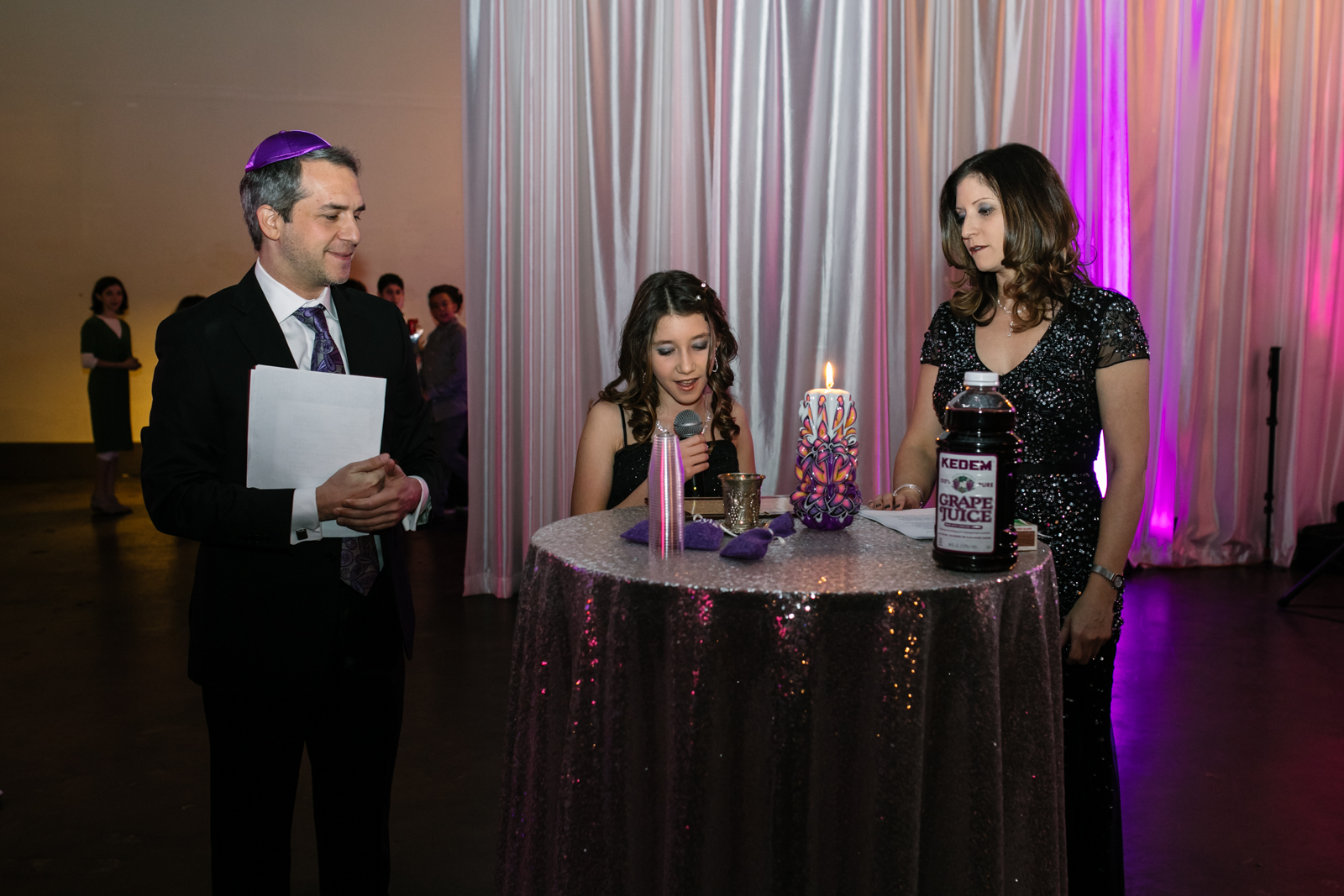 A girl reads a speech at her bat mitzvah