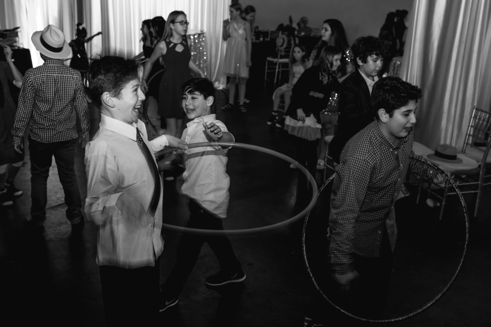 boys hula hoop during a bat mitzvah