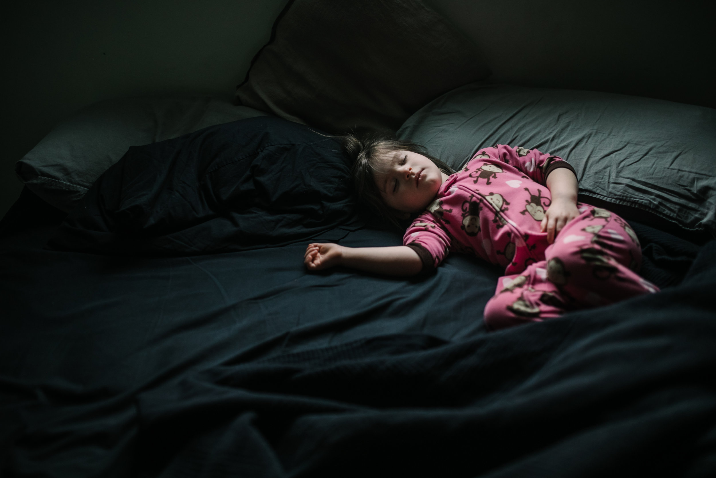Girl sleeps peacefully in a bed