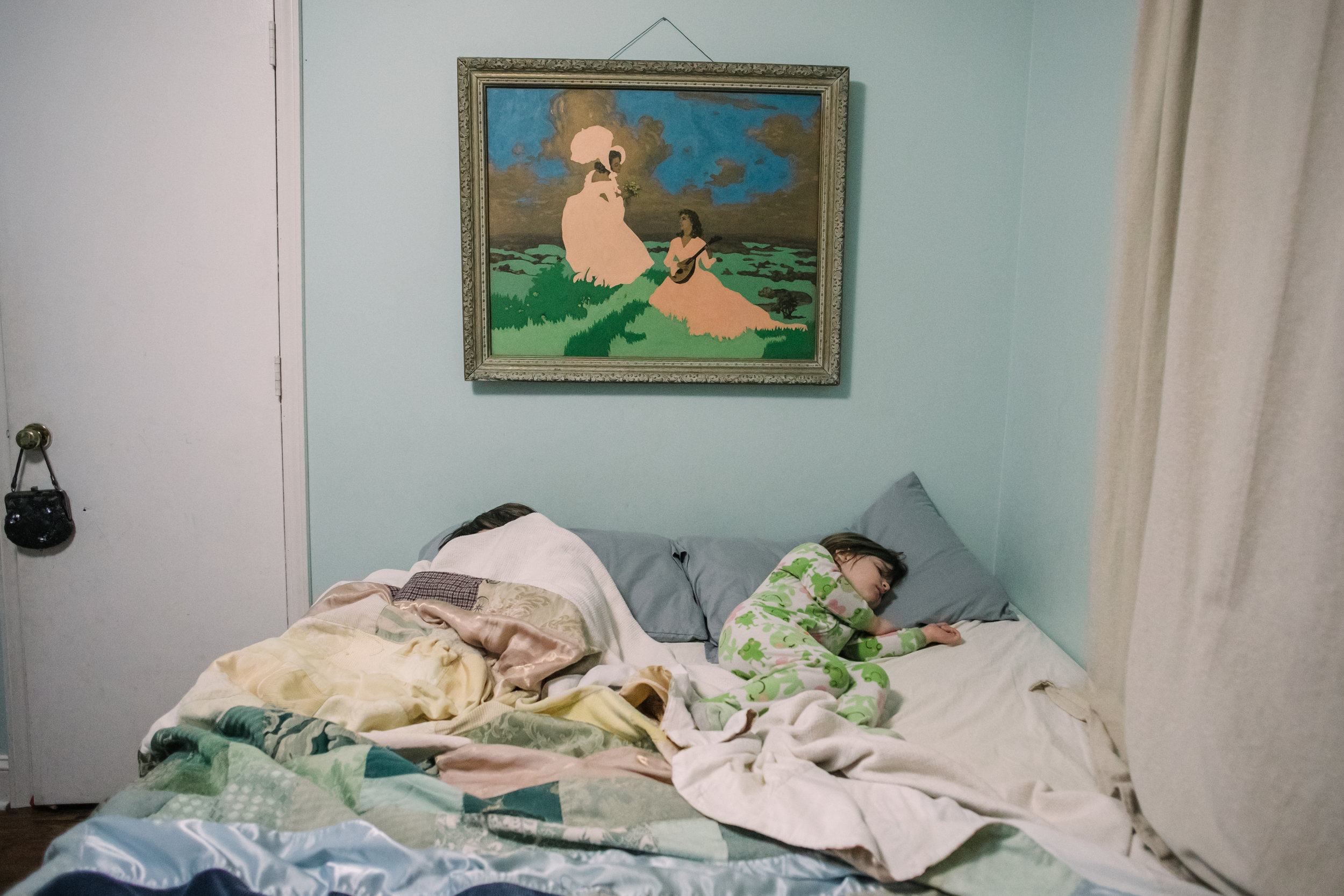 two children sleep in a bed