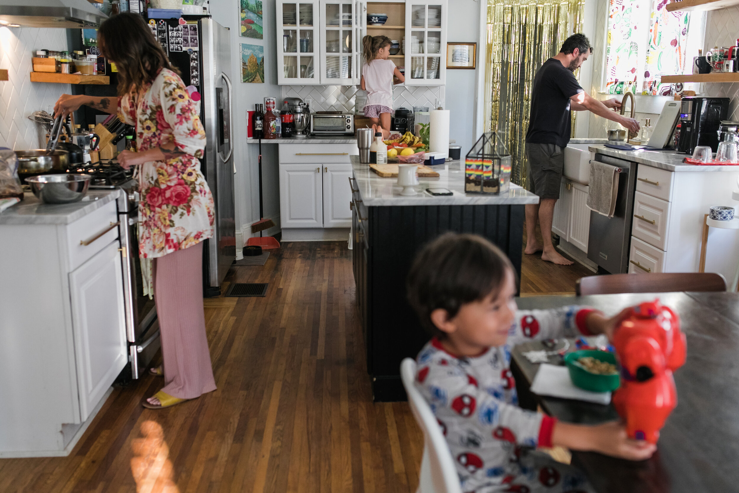 image of a family in a kitchen preparing breakfast from a day in the life photography session