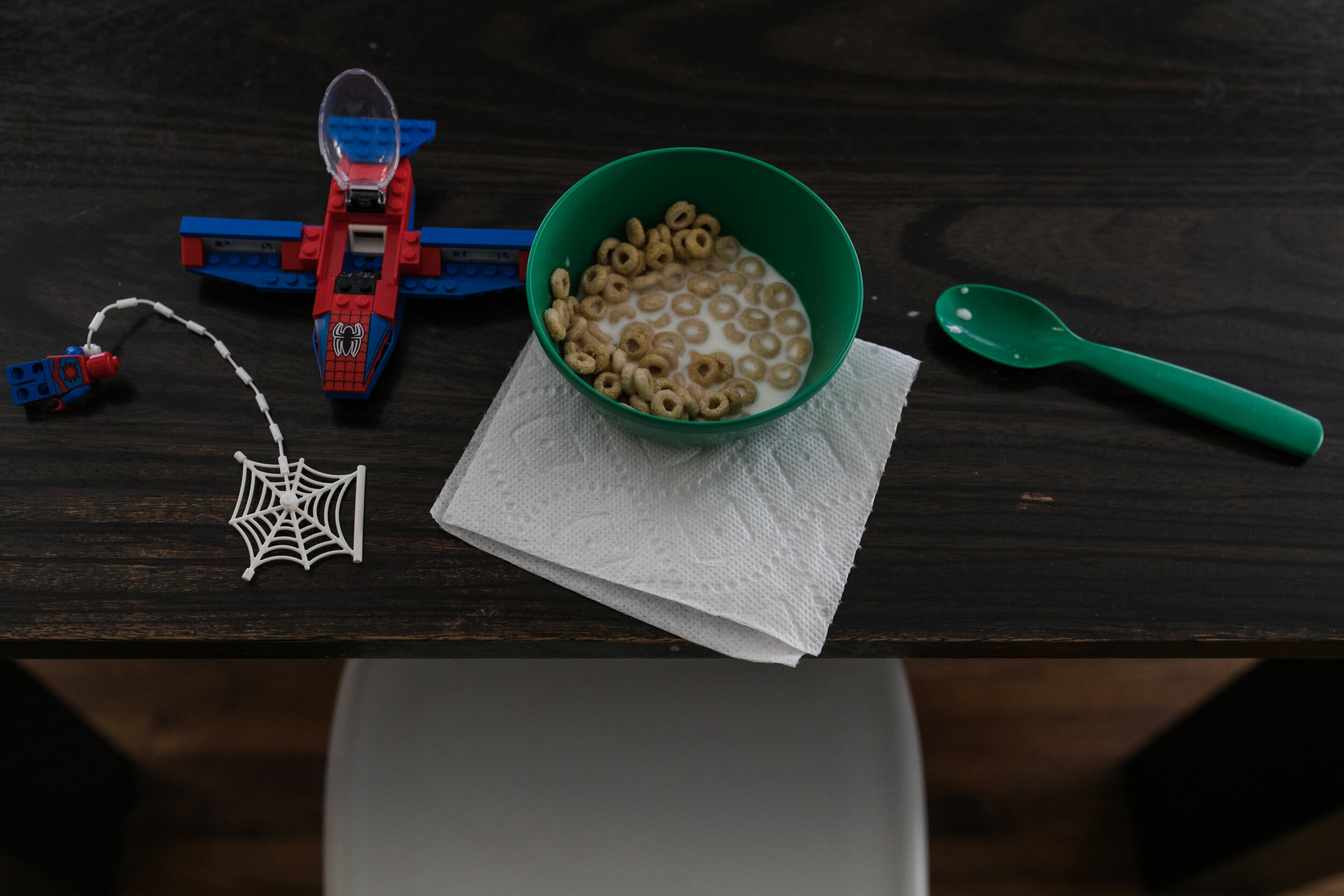 image of a bowl of cereal and spiderman lego toys from a day in the life photography session