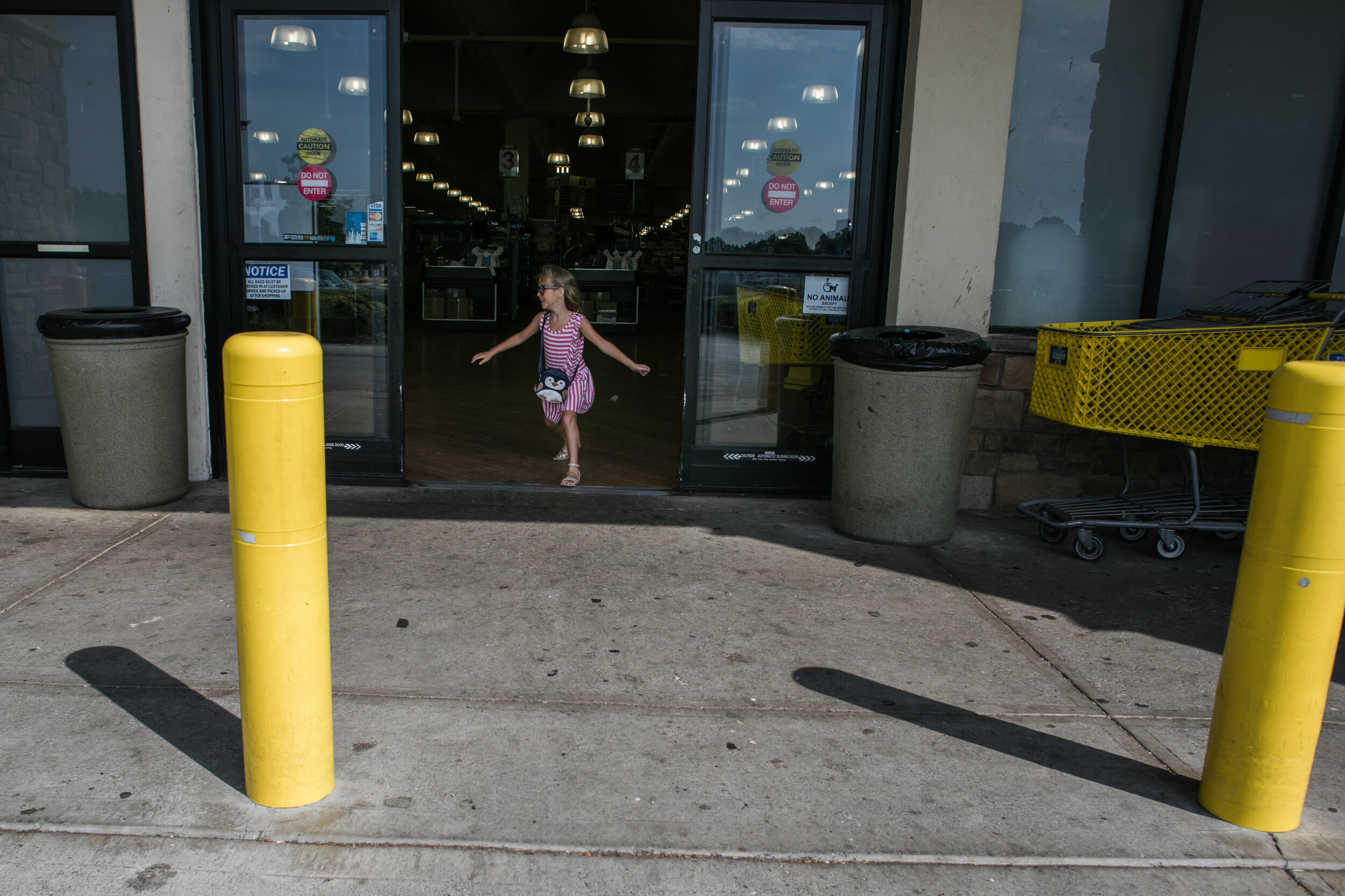 an image of a girl leaving a grocery store from a day in the life photography session