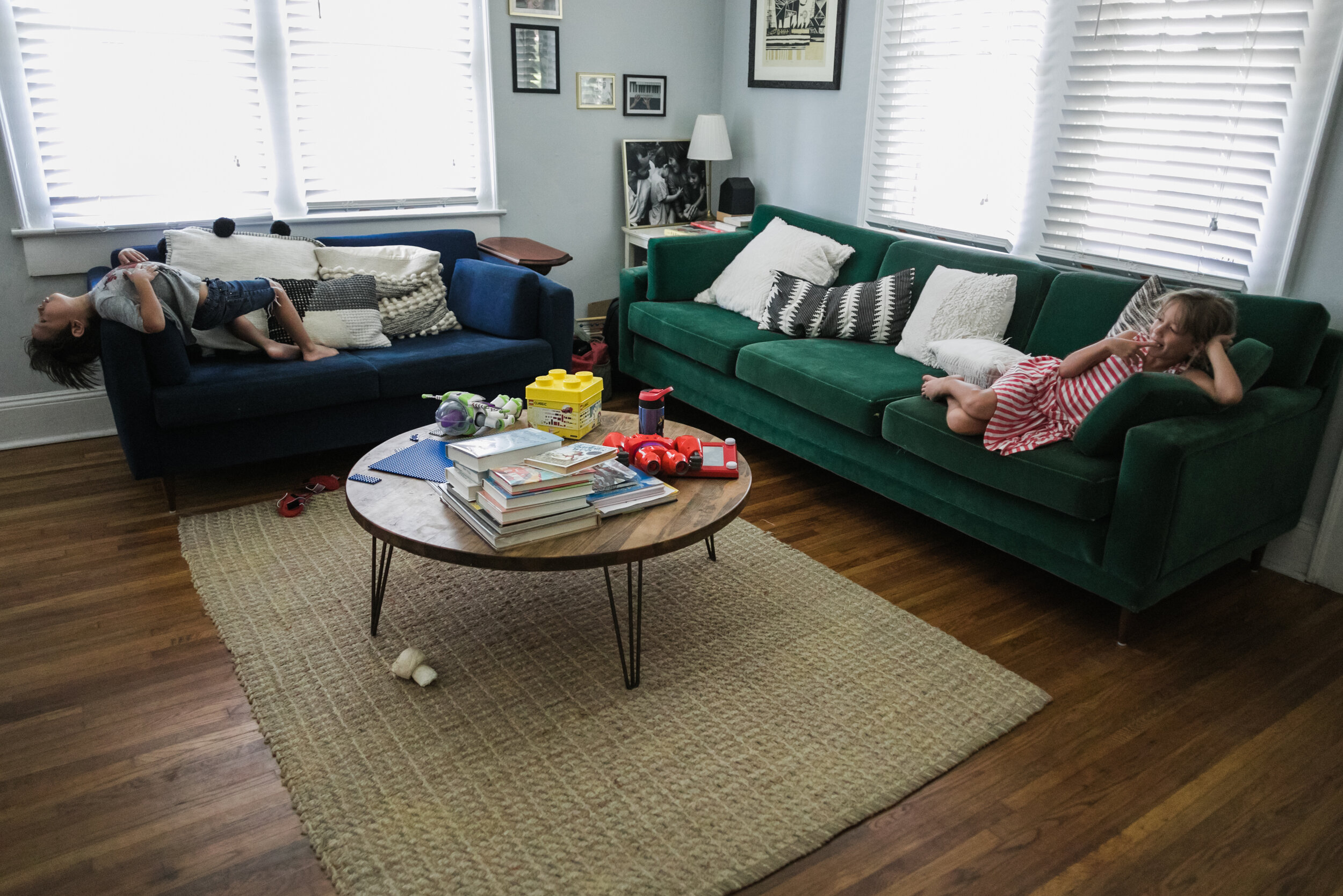 image of two children on two different couches from a day in the life photography session