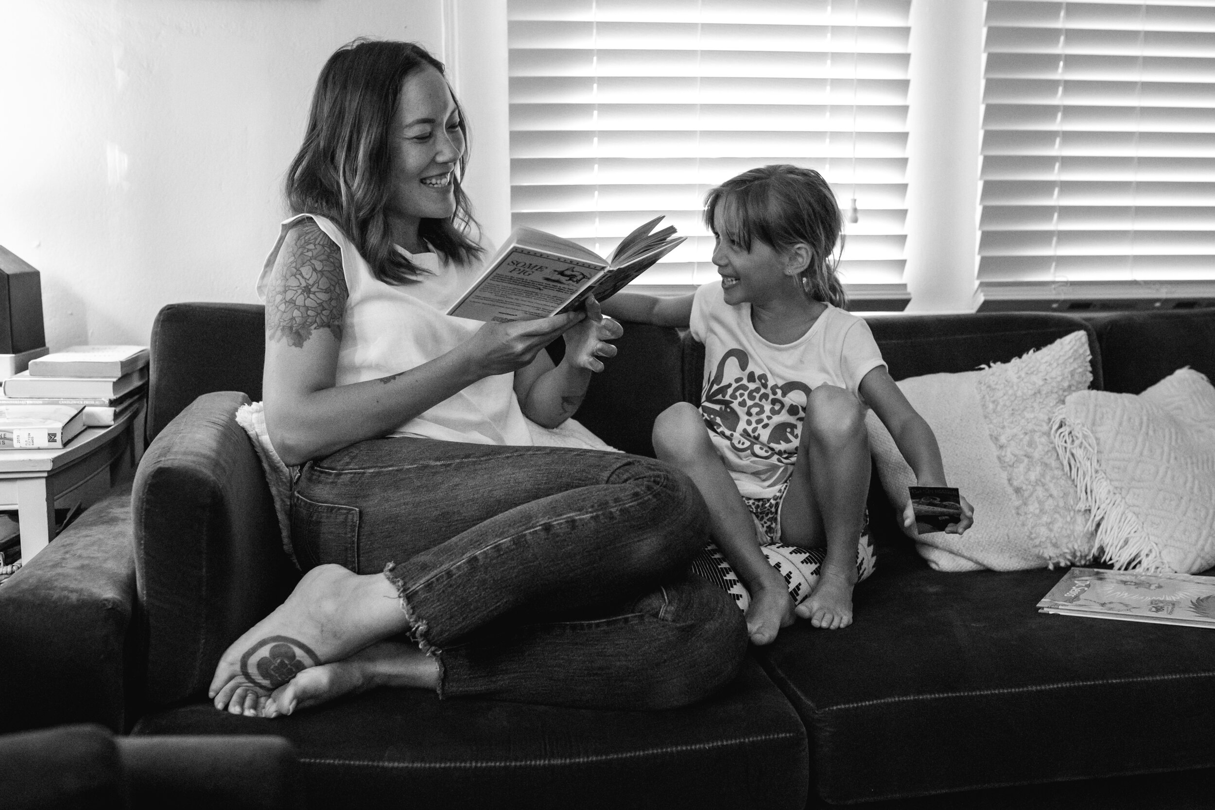 image of a mother and daughter reading together from a day in the life photography session